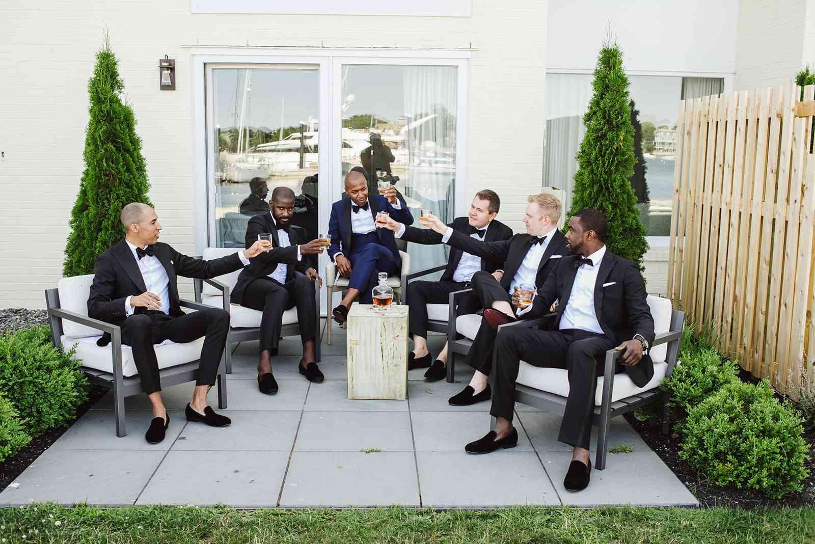Groomsmen drinking together