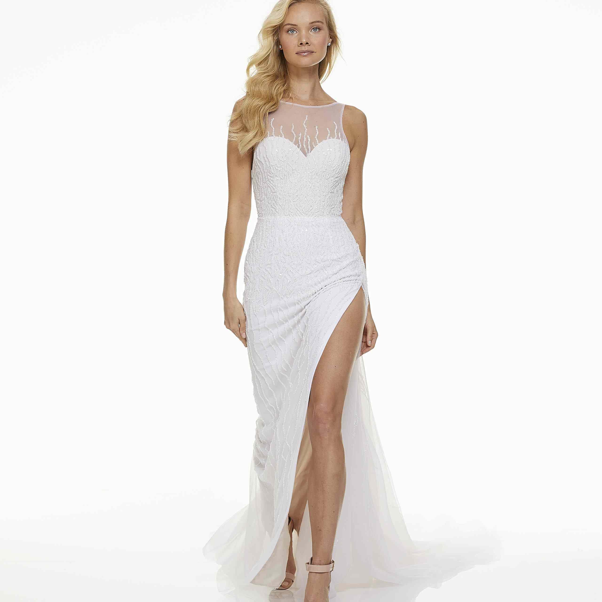 Model in sleeveless embroidered wedding dress
