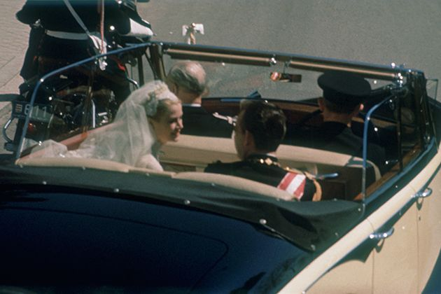 Grace Kelly and Prince Rainier leaving their wedding ceremony in a Rolls Royce