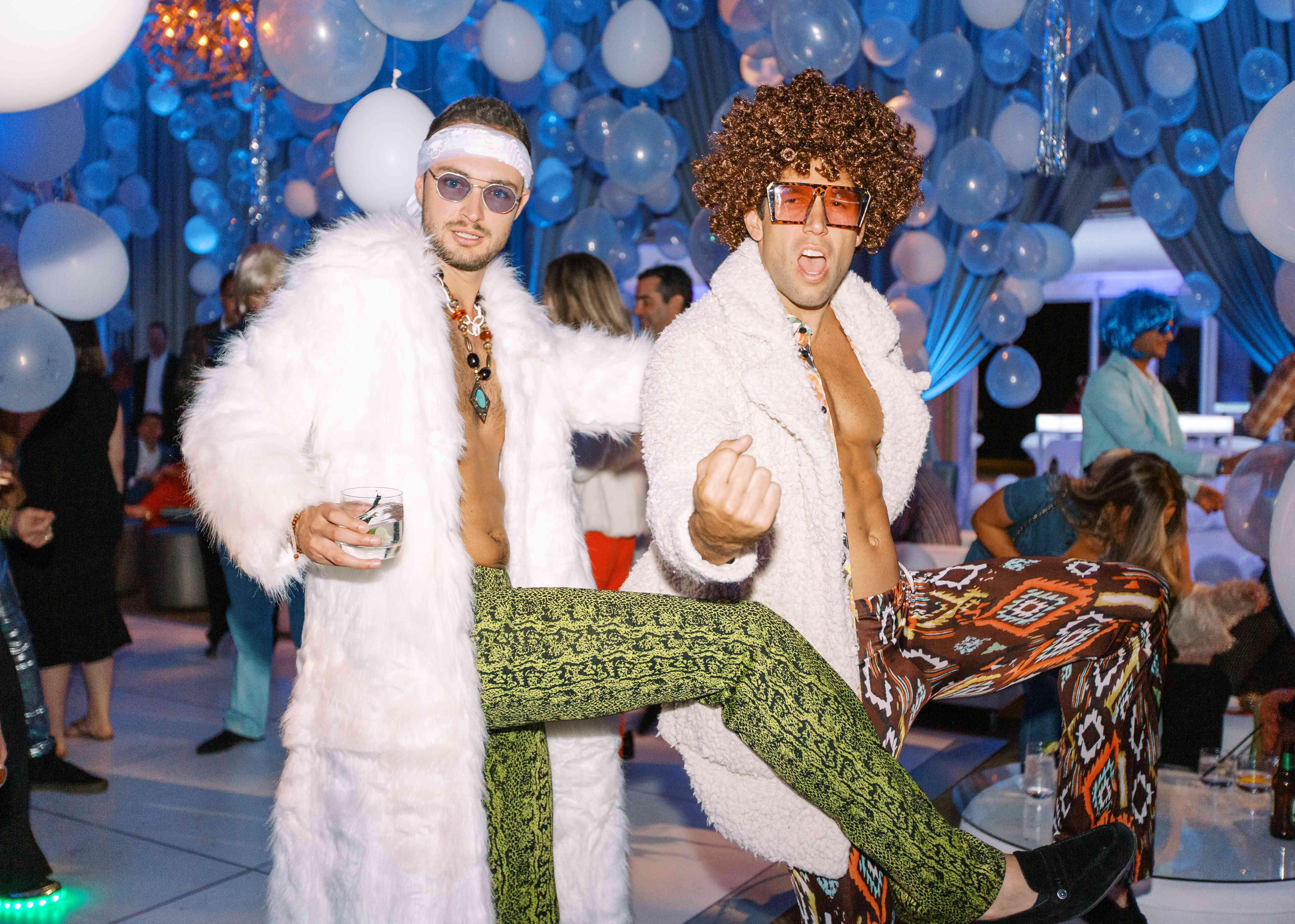 men in disco costumes