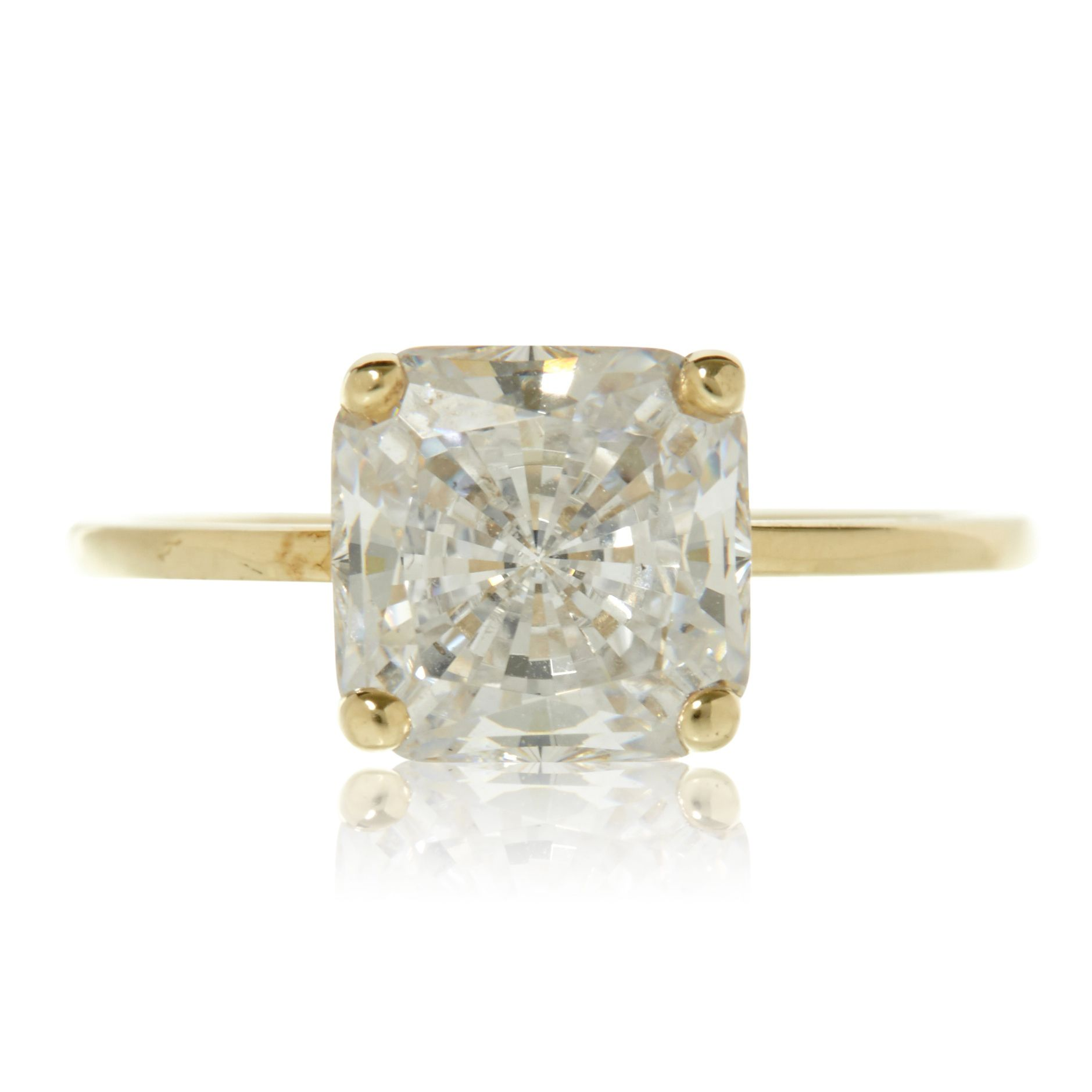 Square Diamond engagement ring with yellow gold band on a white background.