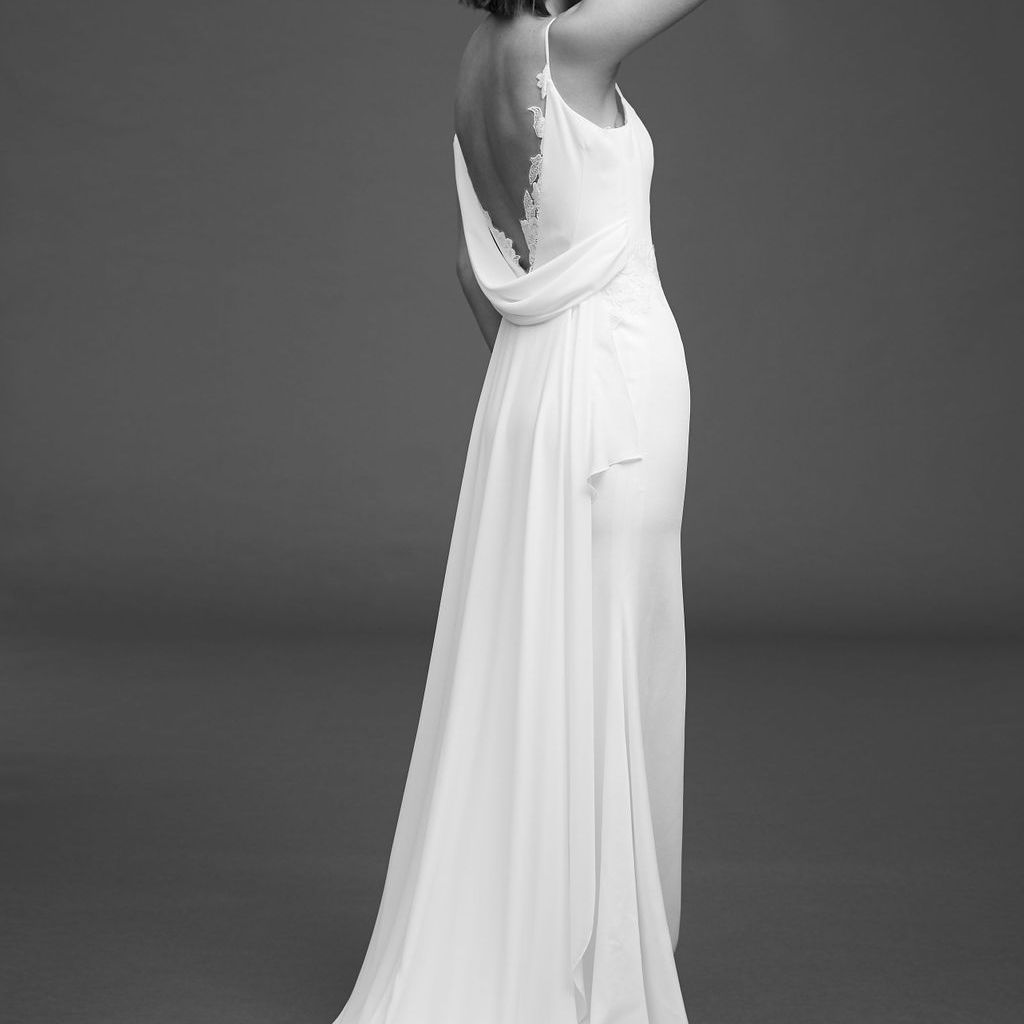 Model in heavy crepe dress with draping and open back