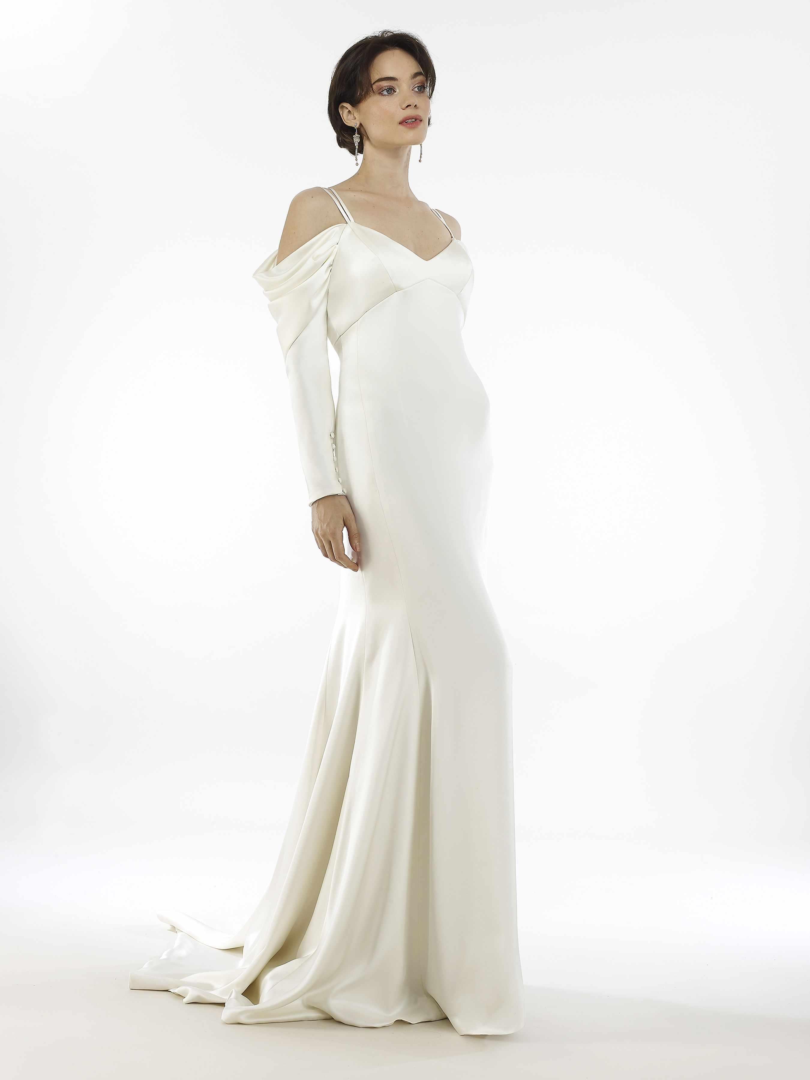 Model in cold-shoulder long-sleeved soft mermaid gown