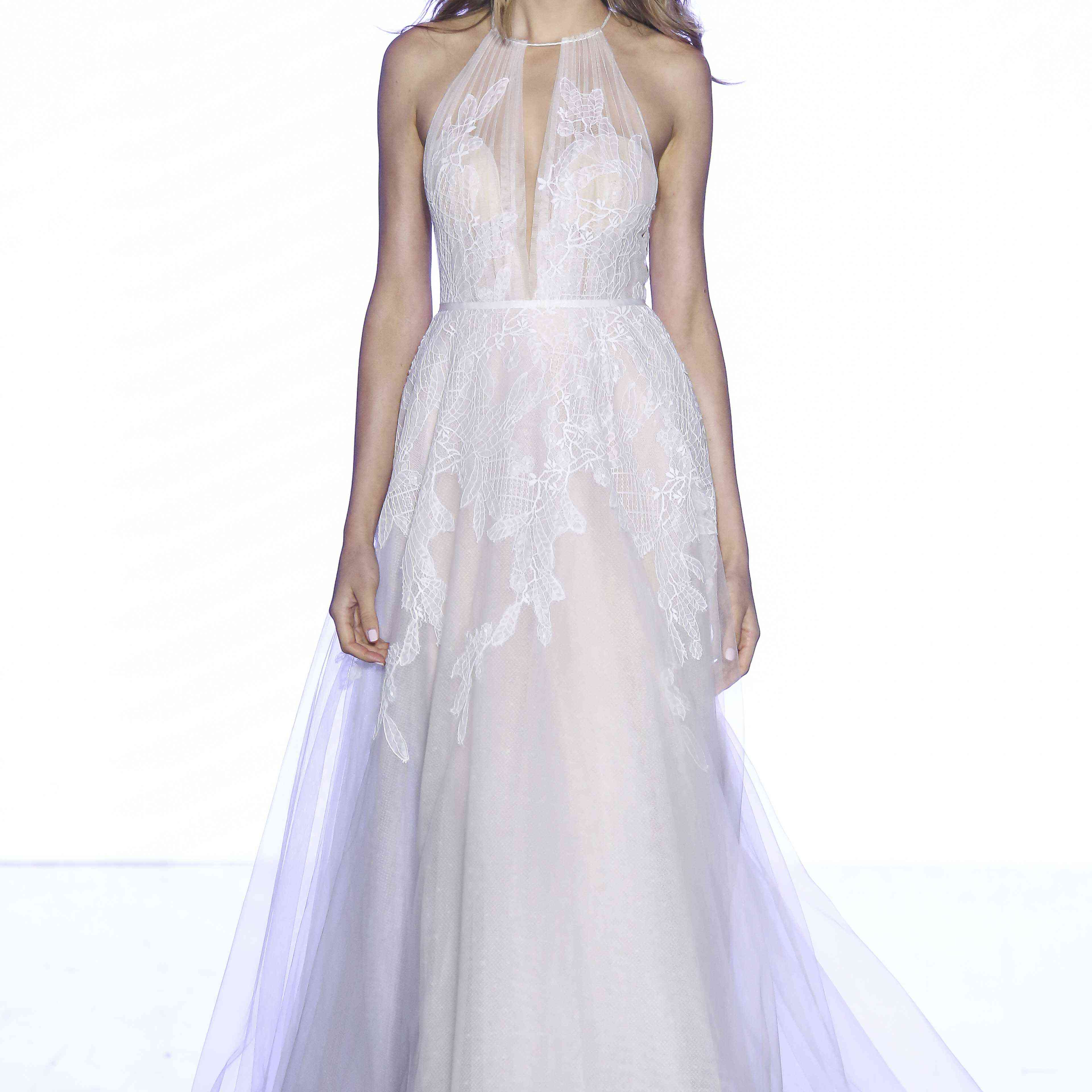 Model in lace and tulle A-line gown with a tie neck