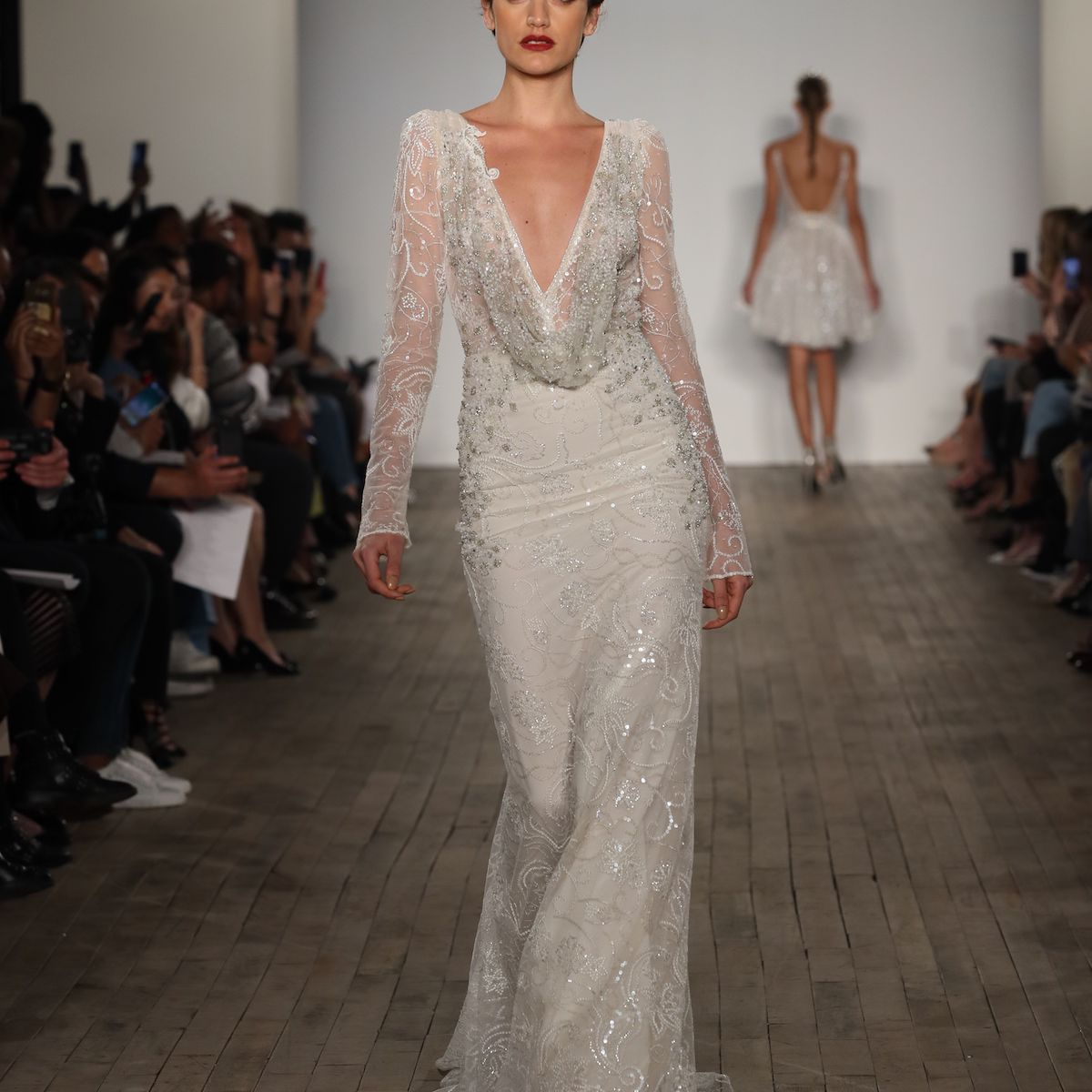 Model in deep V-cut cowl neck wedding dress