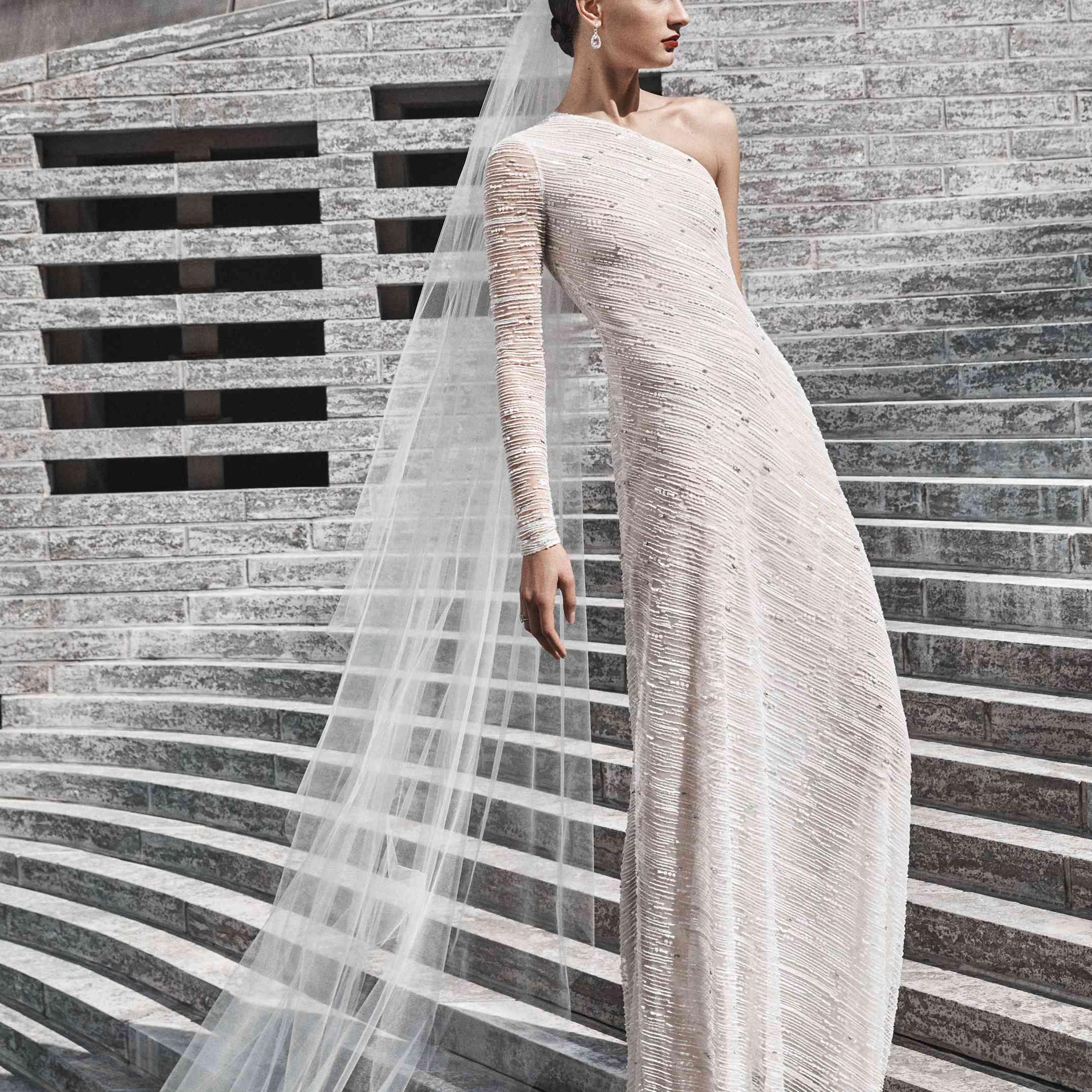 Model in one-shoulder beaded gown