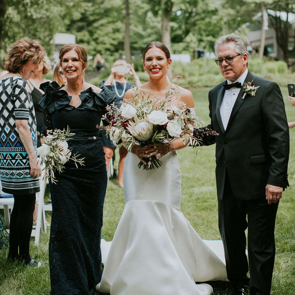 Meaghan is escorted up the aisle by her parents