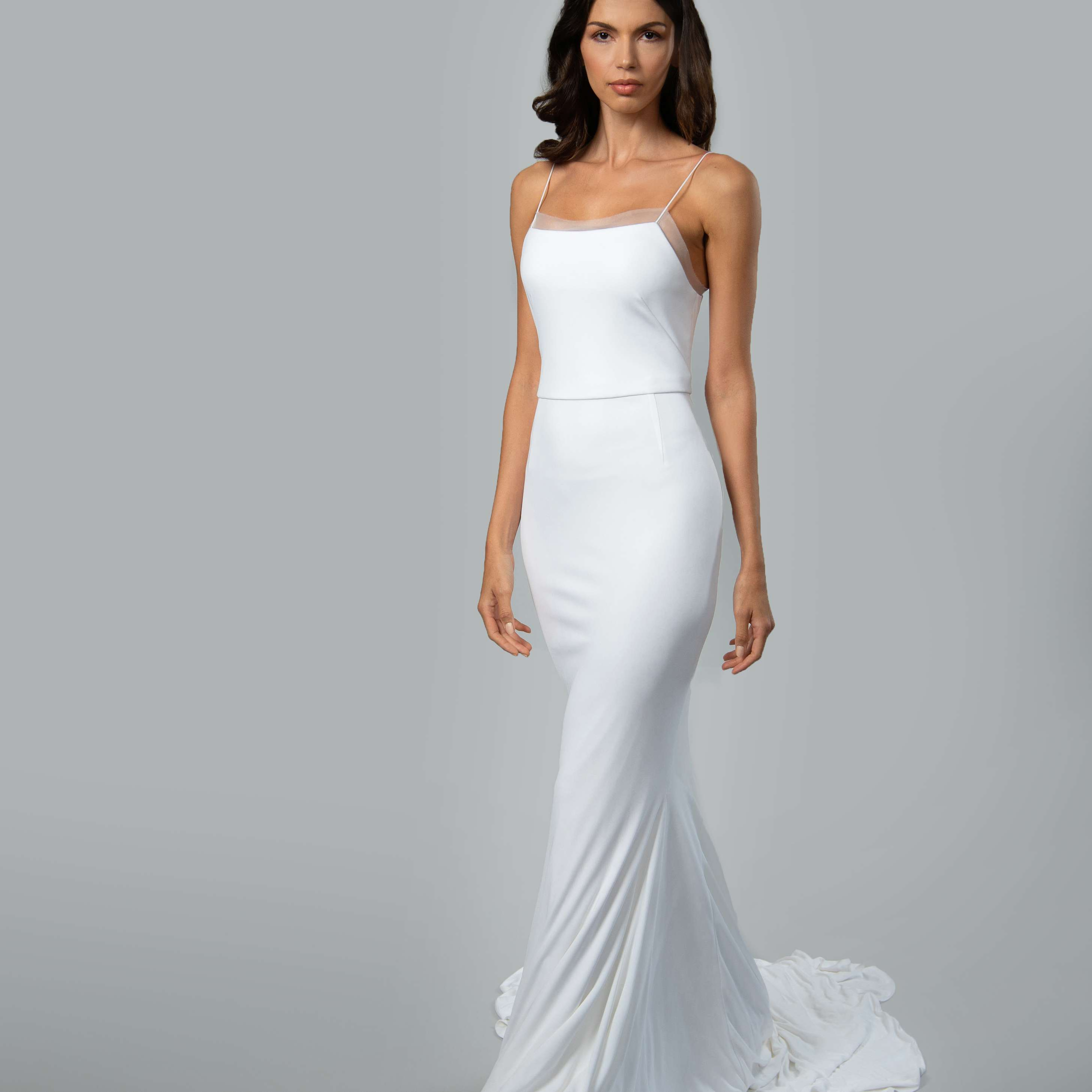 Model in spaghetti strap slip wedding dress