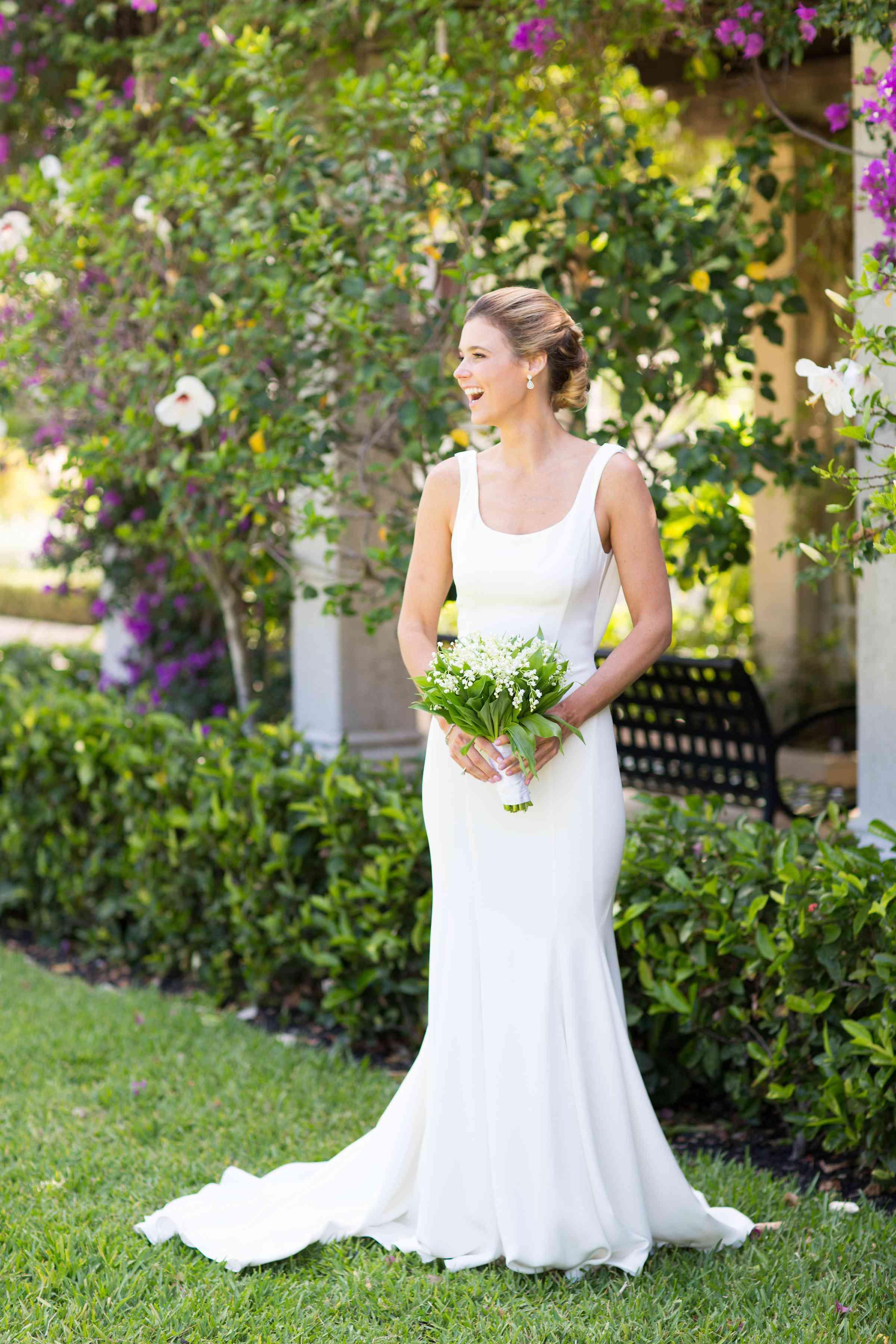Solo bride holding bouquet
