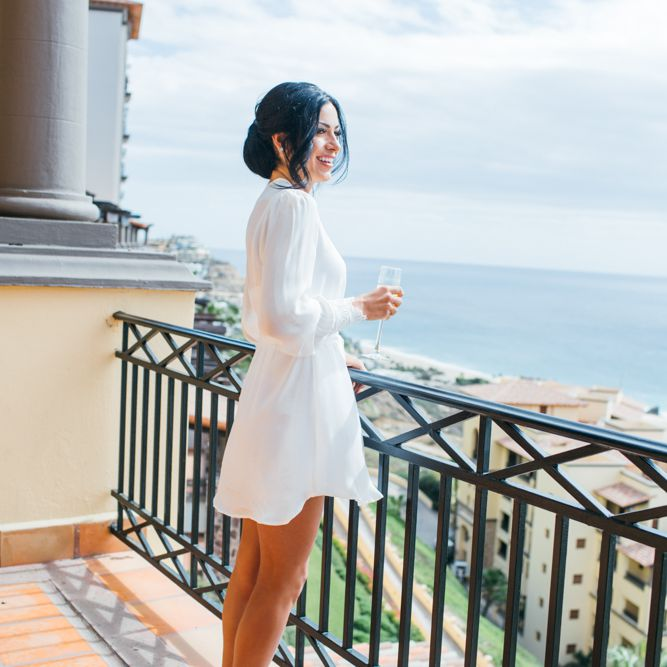 Bride getting ready before wedding with champagne