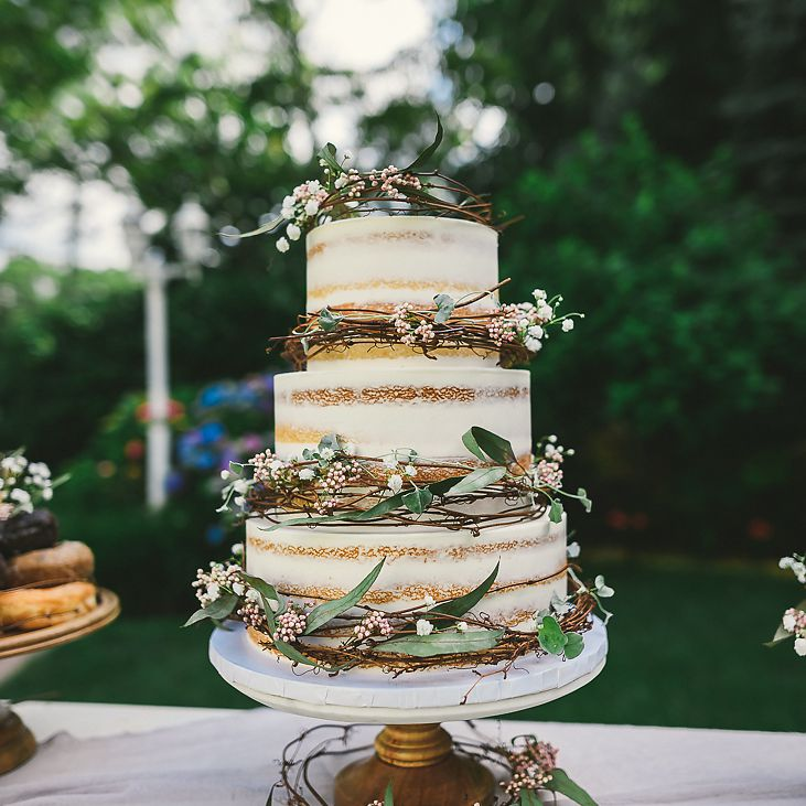 Semi-naked tiered wedding cake with fall-inspired twigs and florals