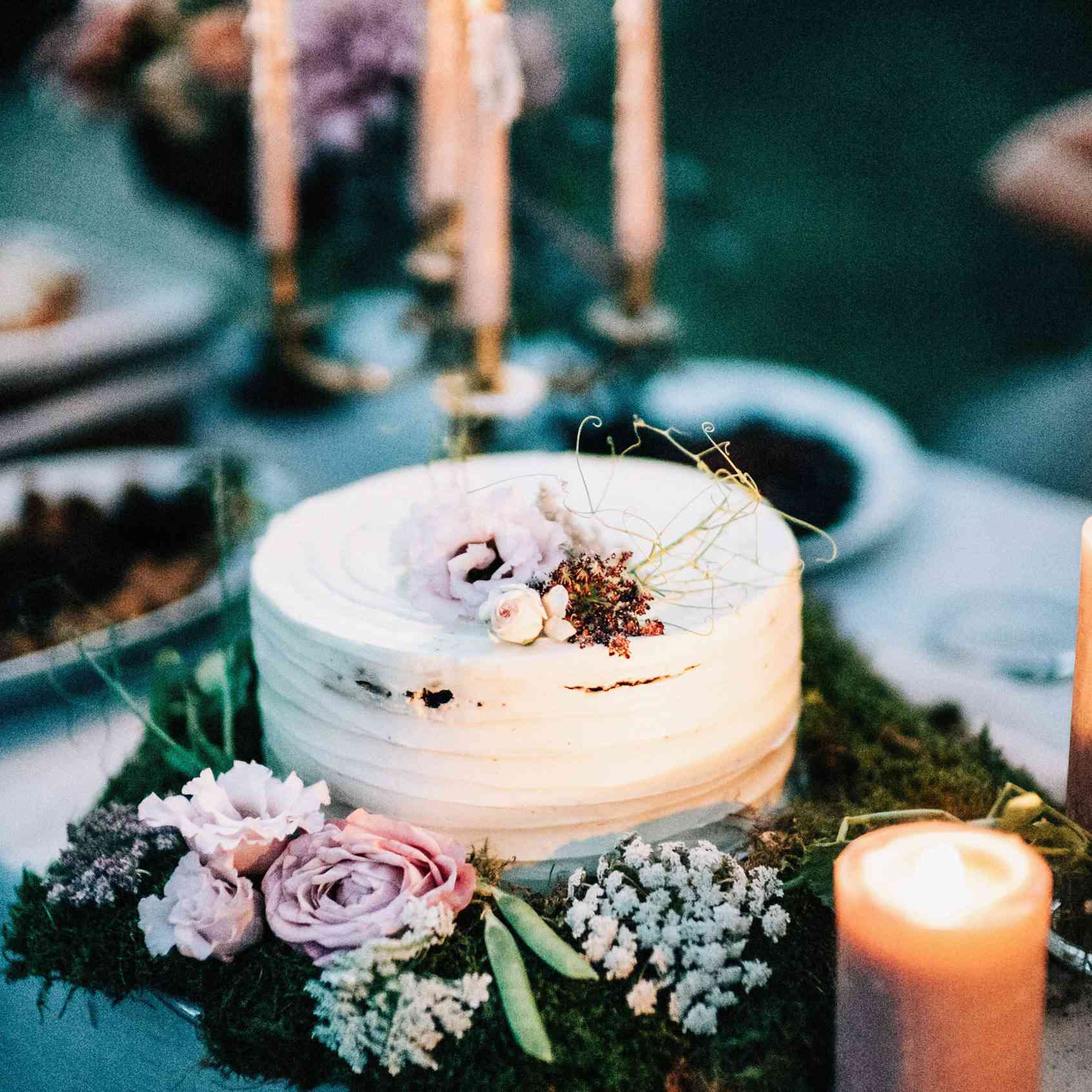 A simple wedding cake on a wreath