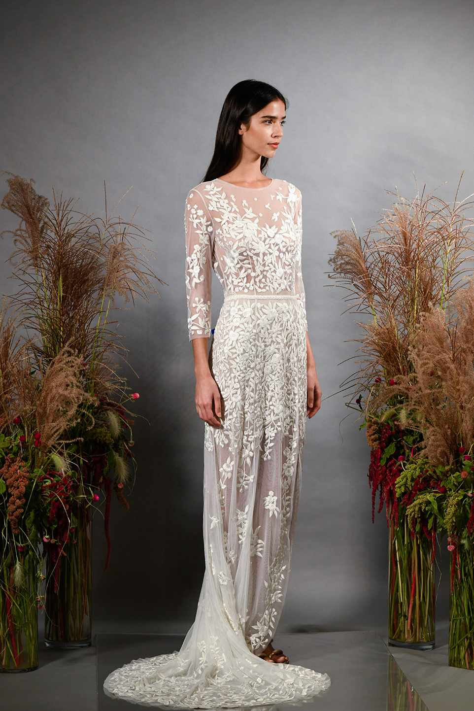 Model in sheer sleeved wedding dress