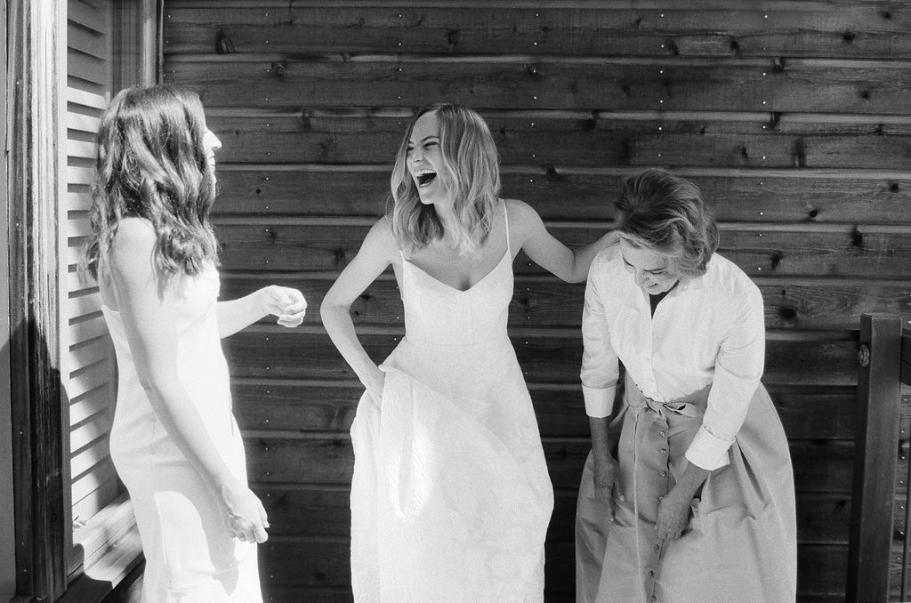 bride laughing with two women