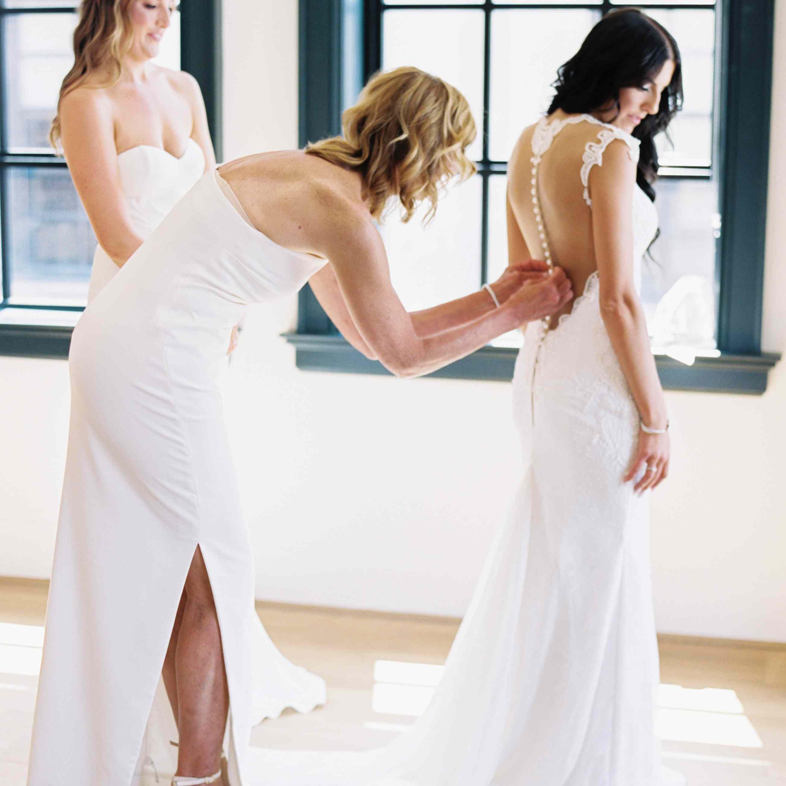 Sarah puts on her wedding dress