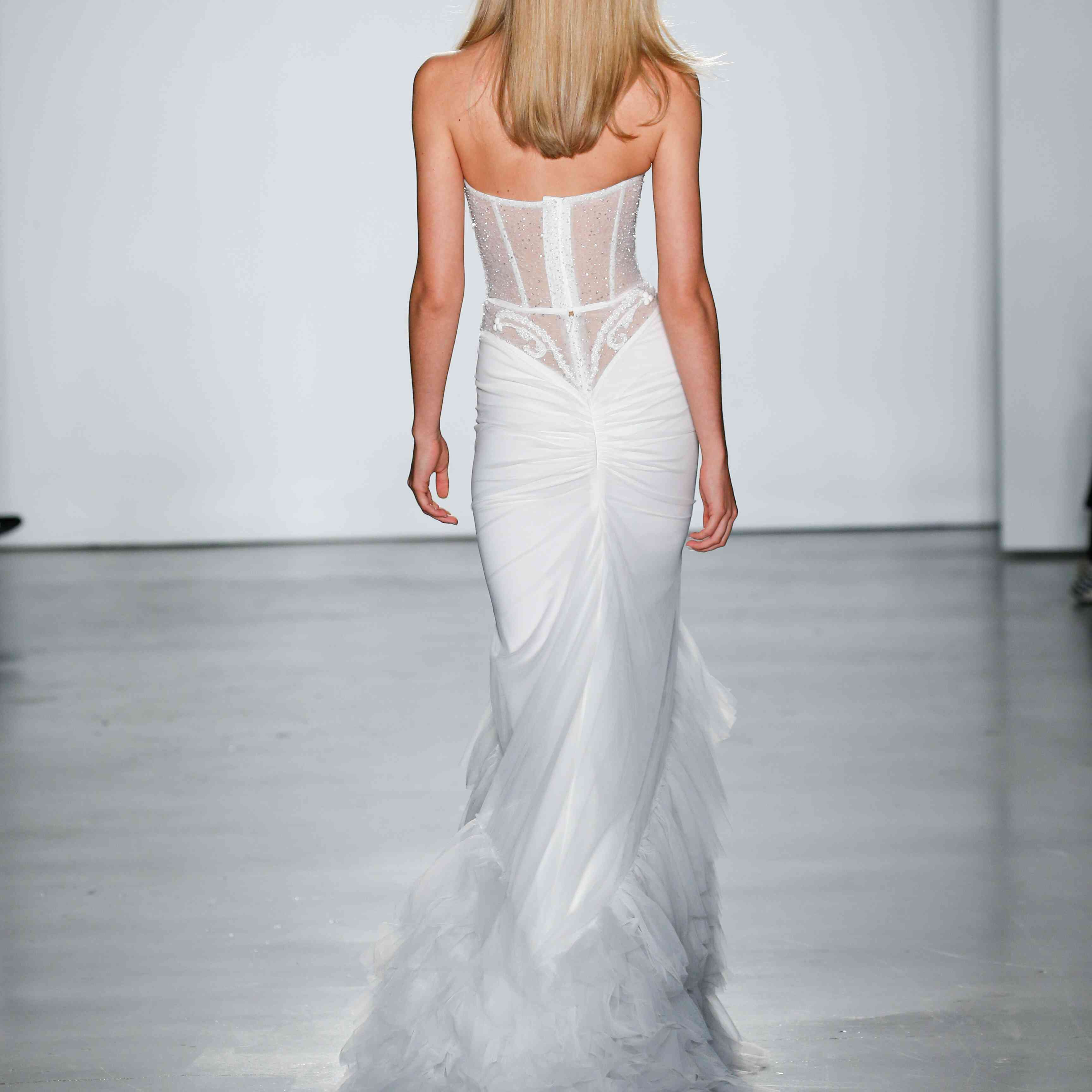 Model in ruffled VIP dress