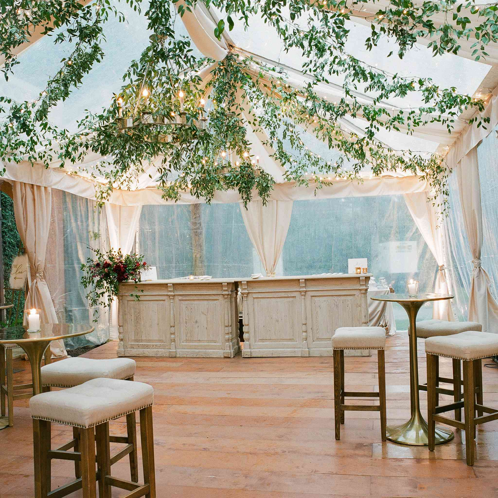 Tent interior detail with greenery and warm lighting