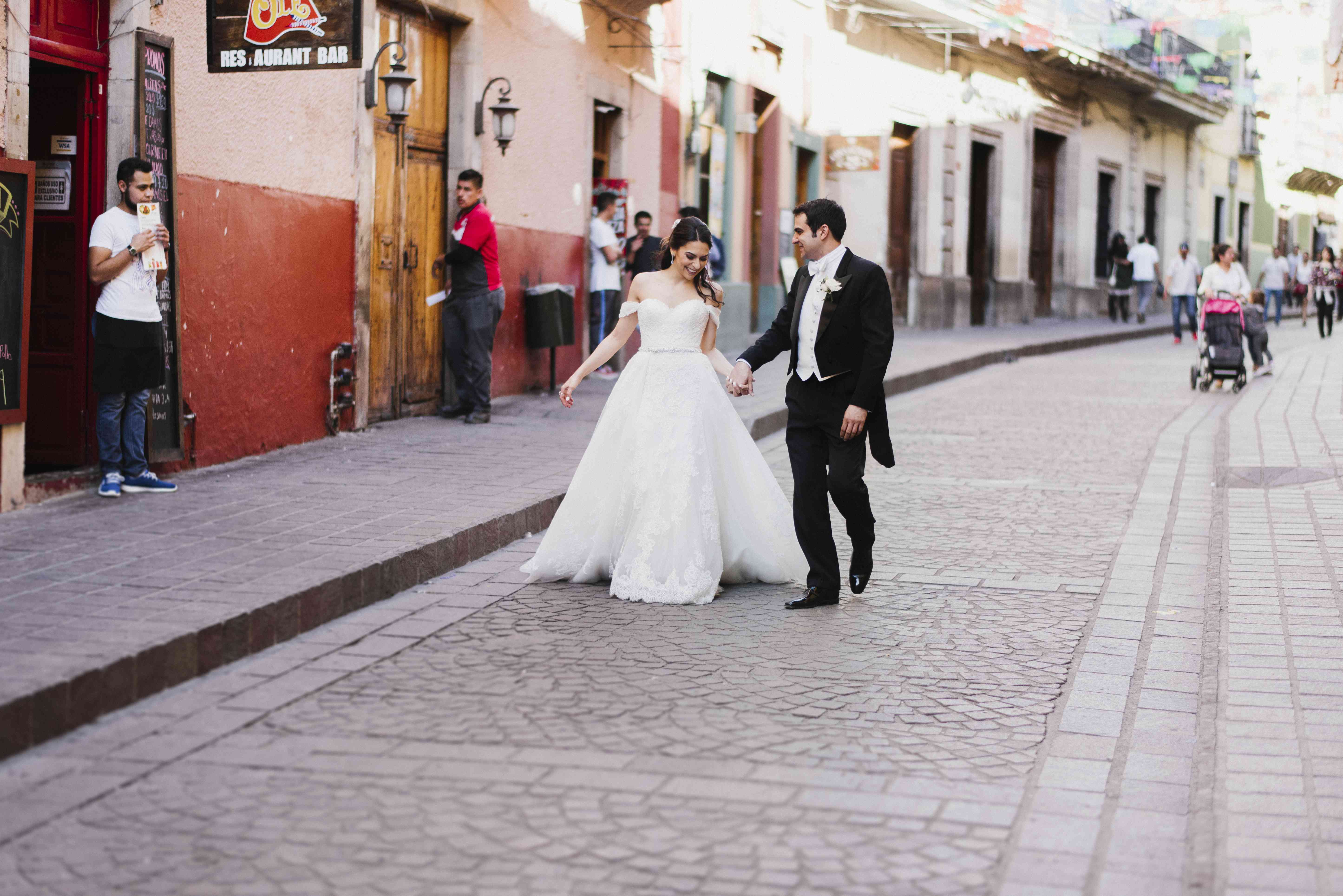 bride and groom walking the streets