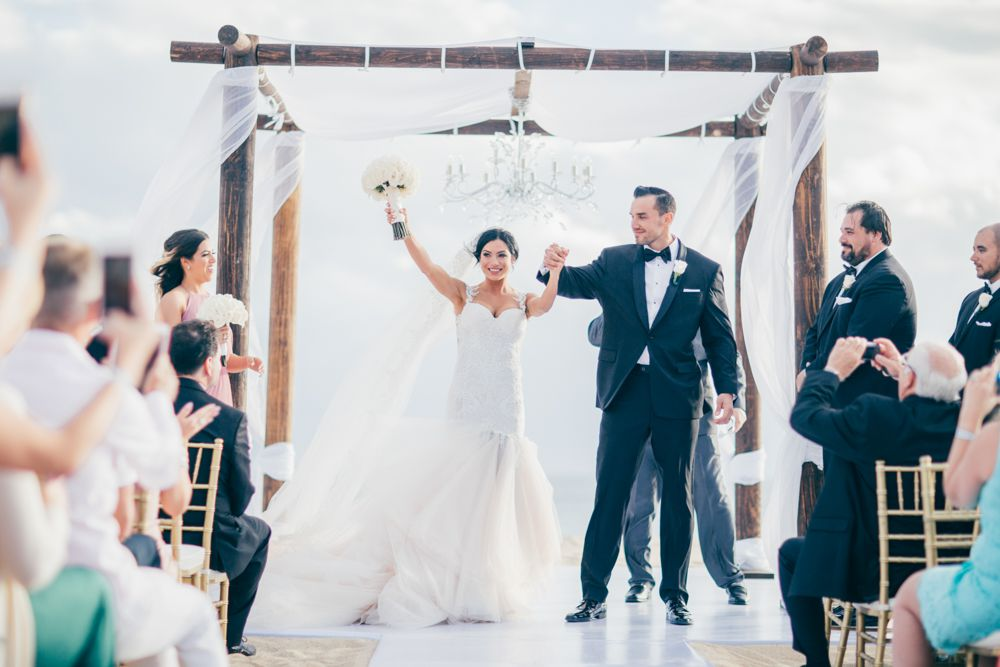 Bride and groom recessional under chuppah