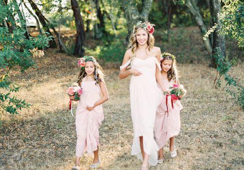 Junior bridesmaid and flower girls walking