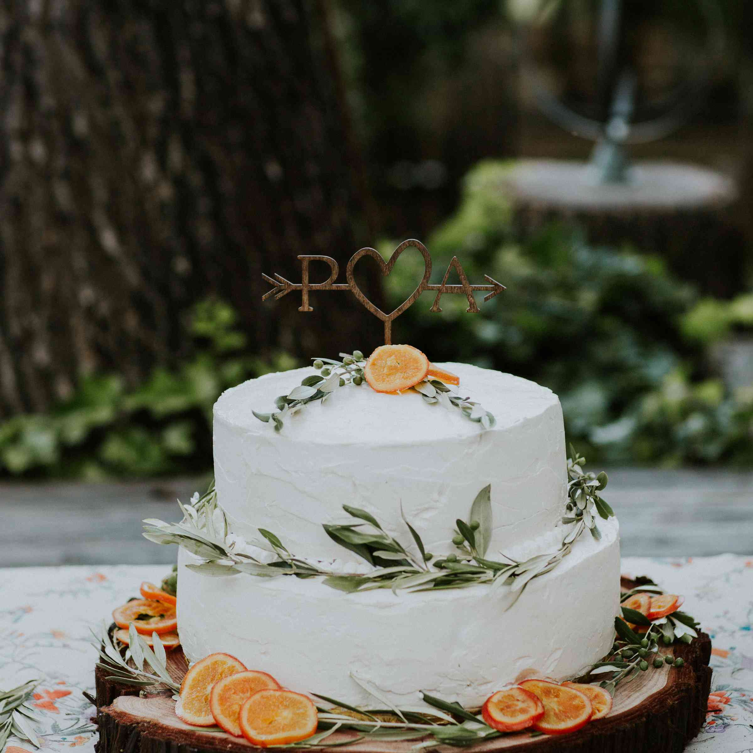 A white wedding cake with orange slices