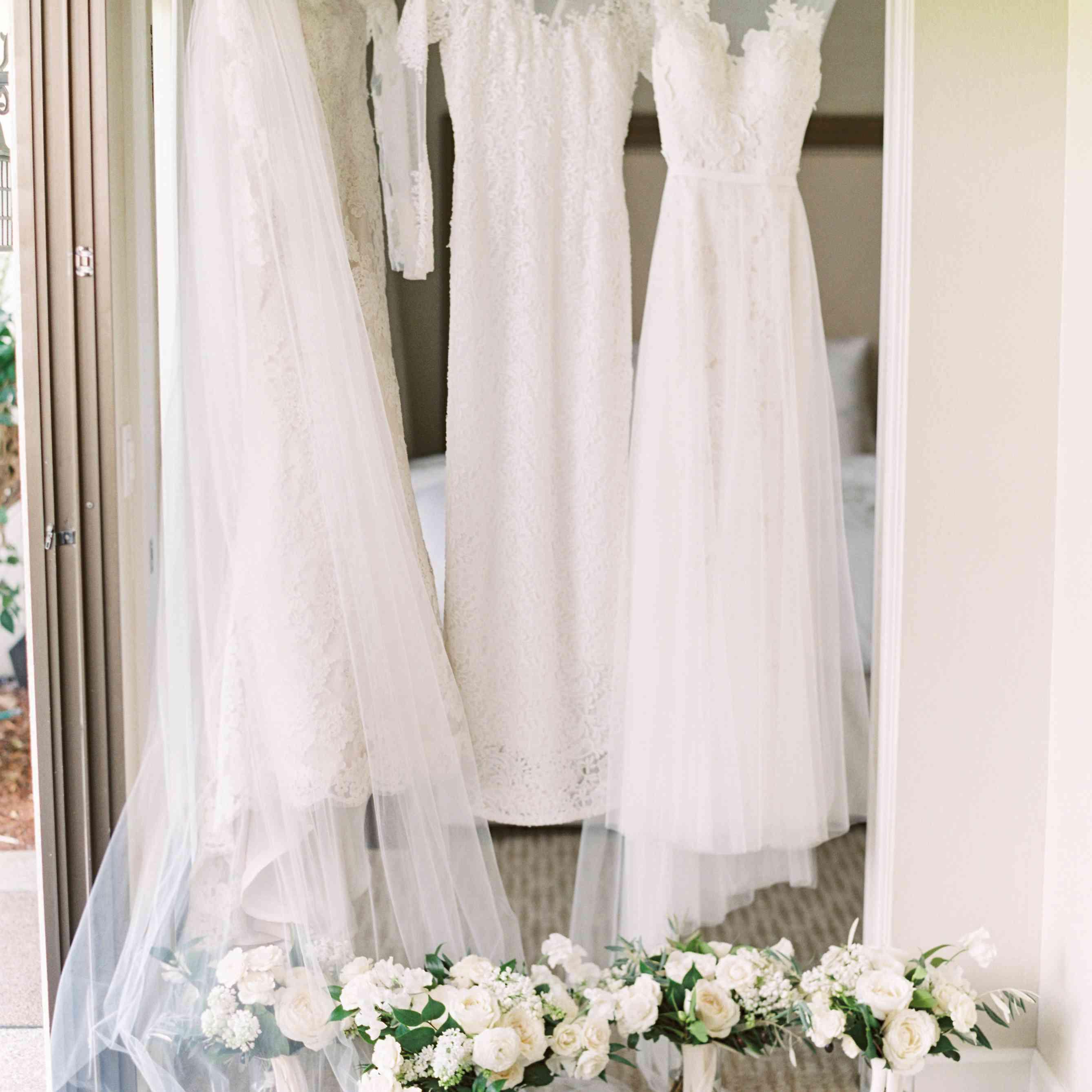 three wedding dresses