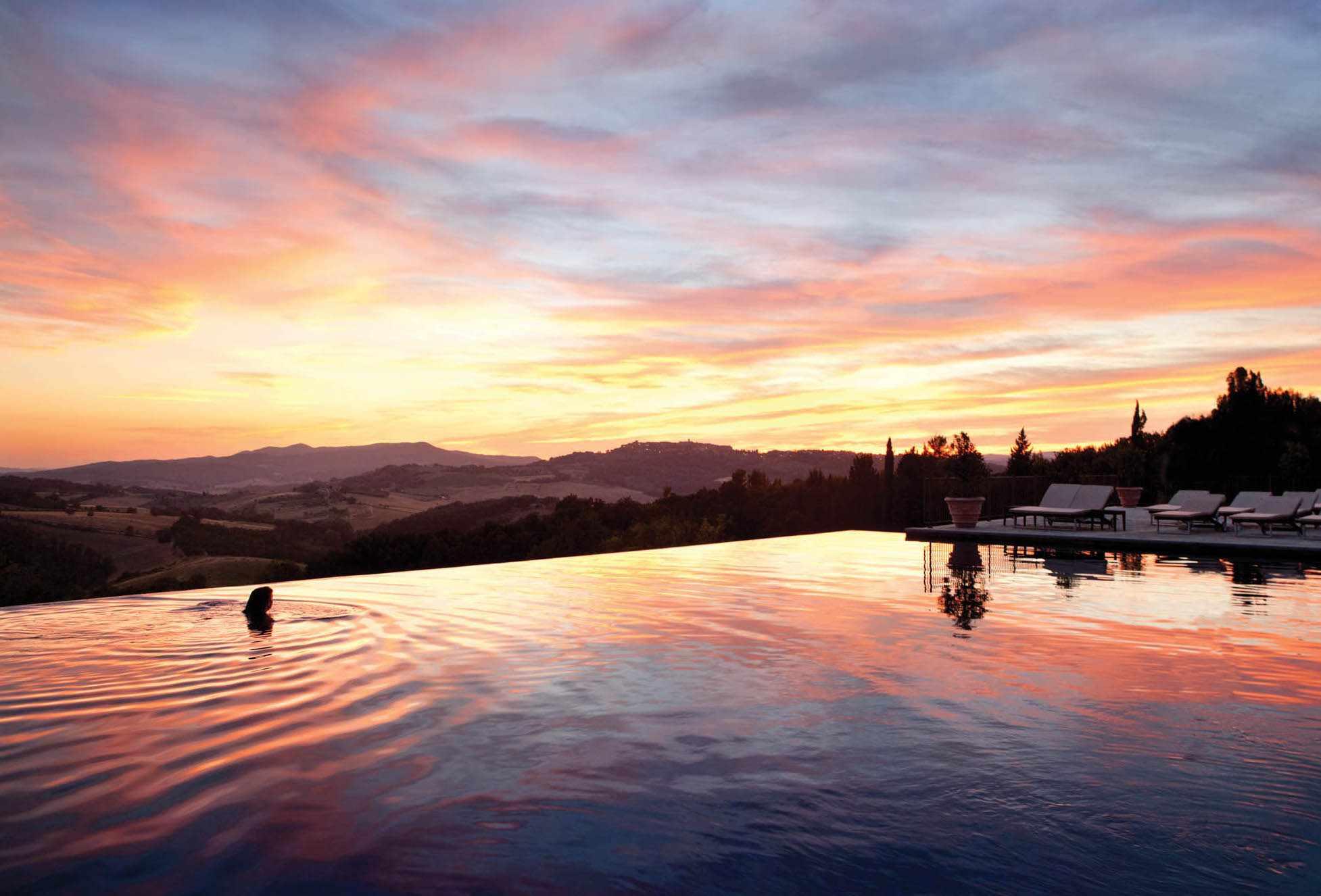Pool sunset view at Belmond Castello di Casole