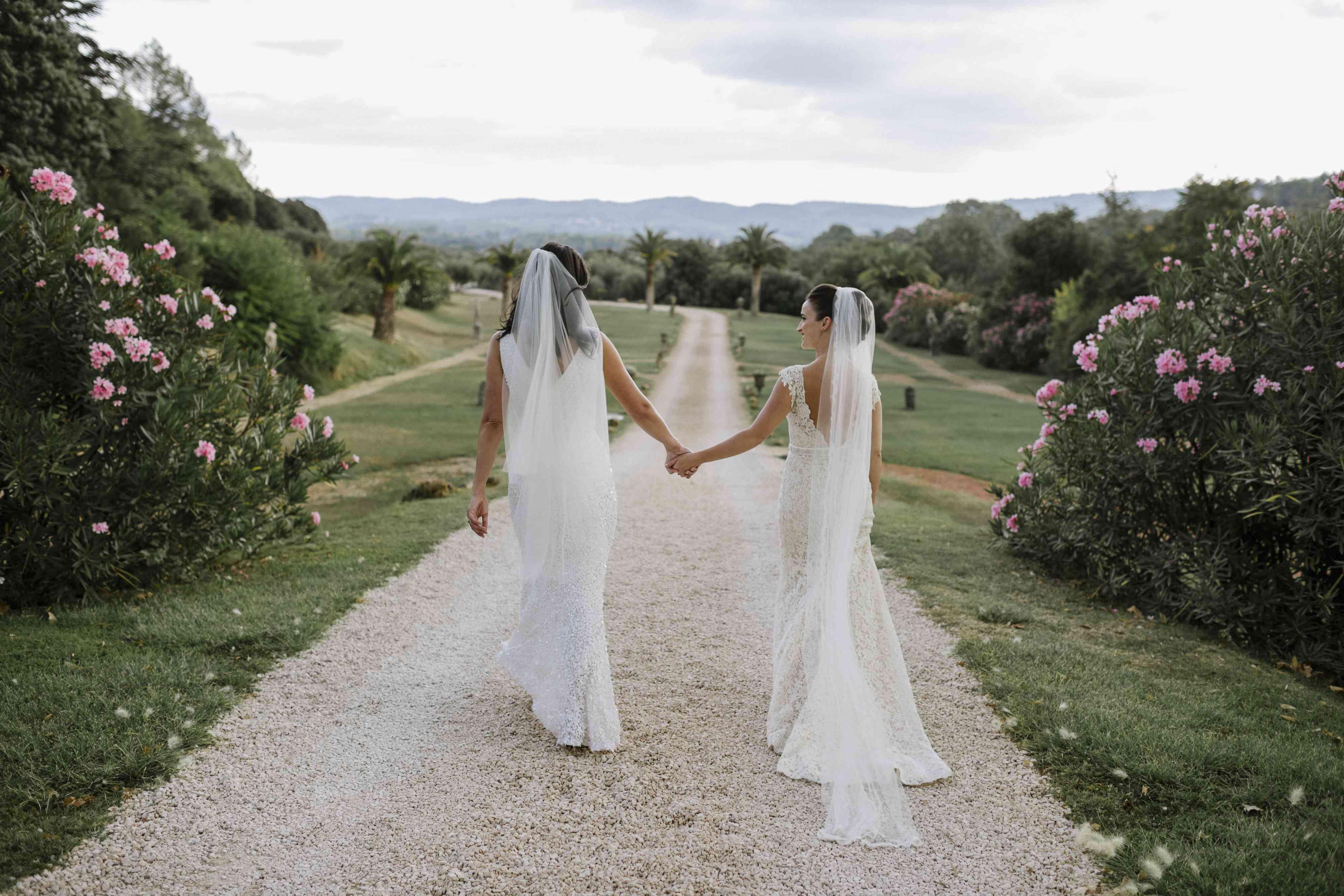 <p>brides holding hands</p><br><br>