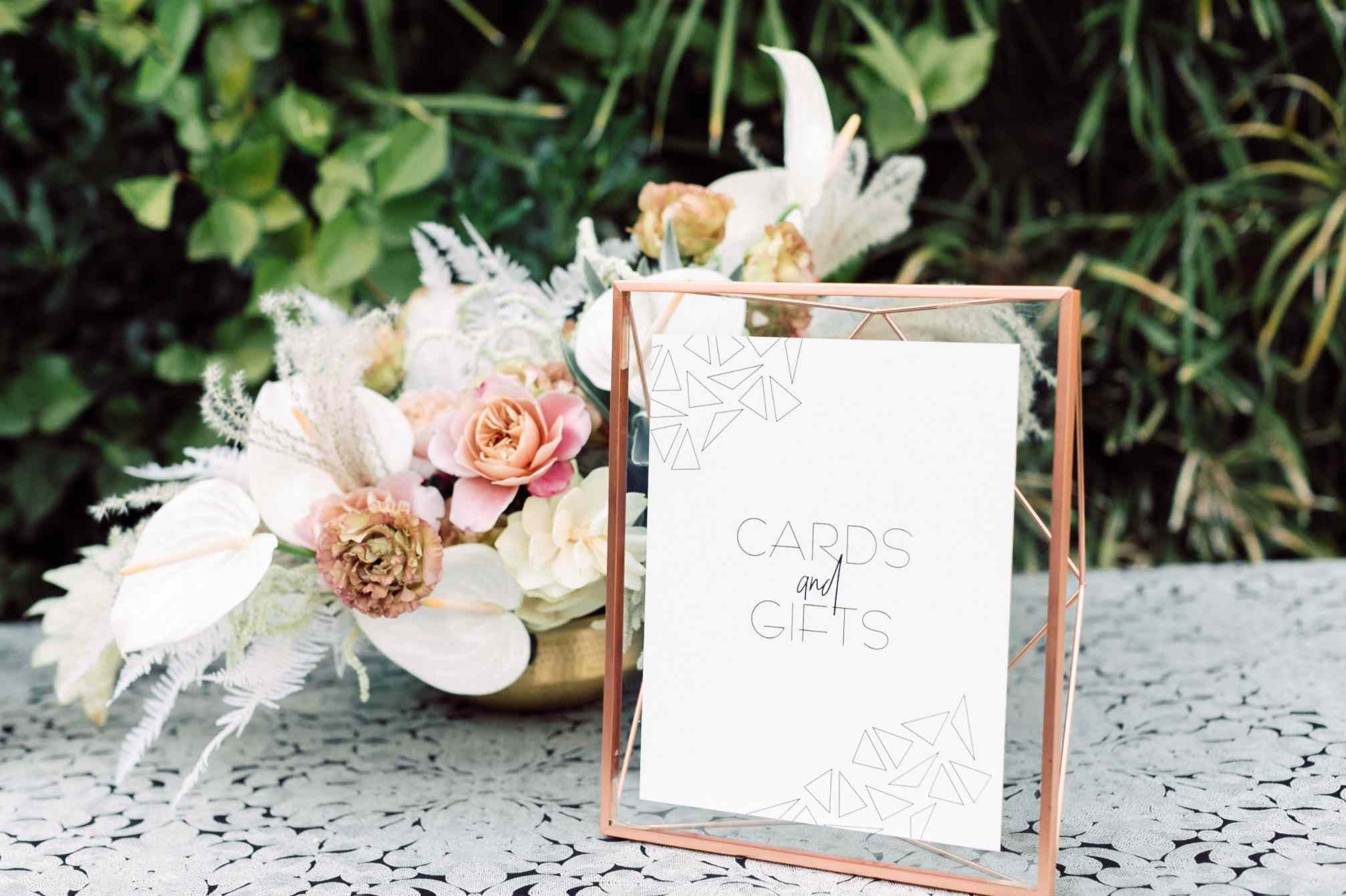 Gift signage with floral centerpiece