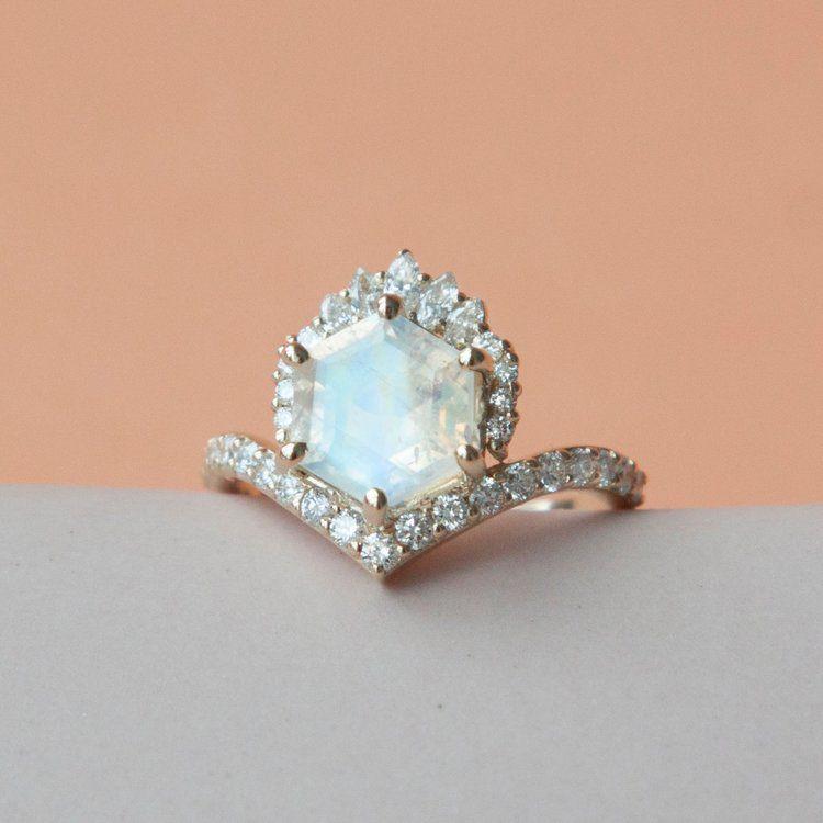 Hexagon-cut rainbow moonstone with diamond crown and diamond pave v-shaped band