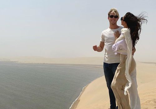 couple standing in desert