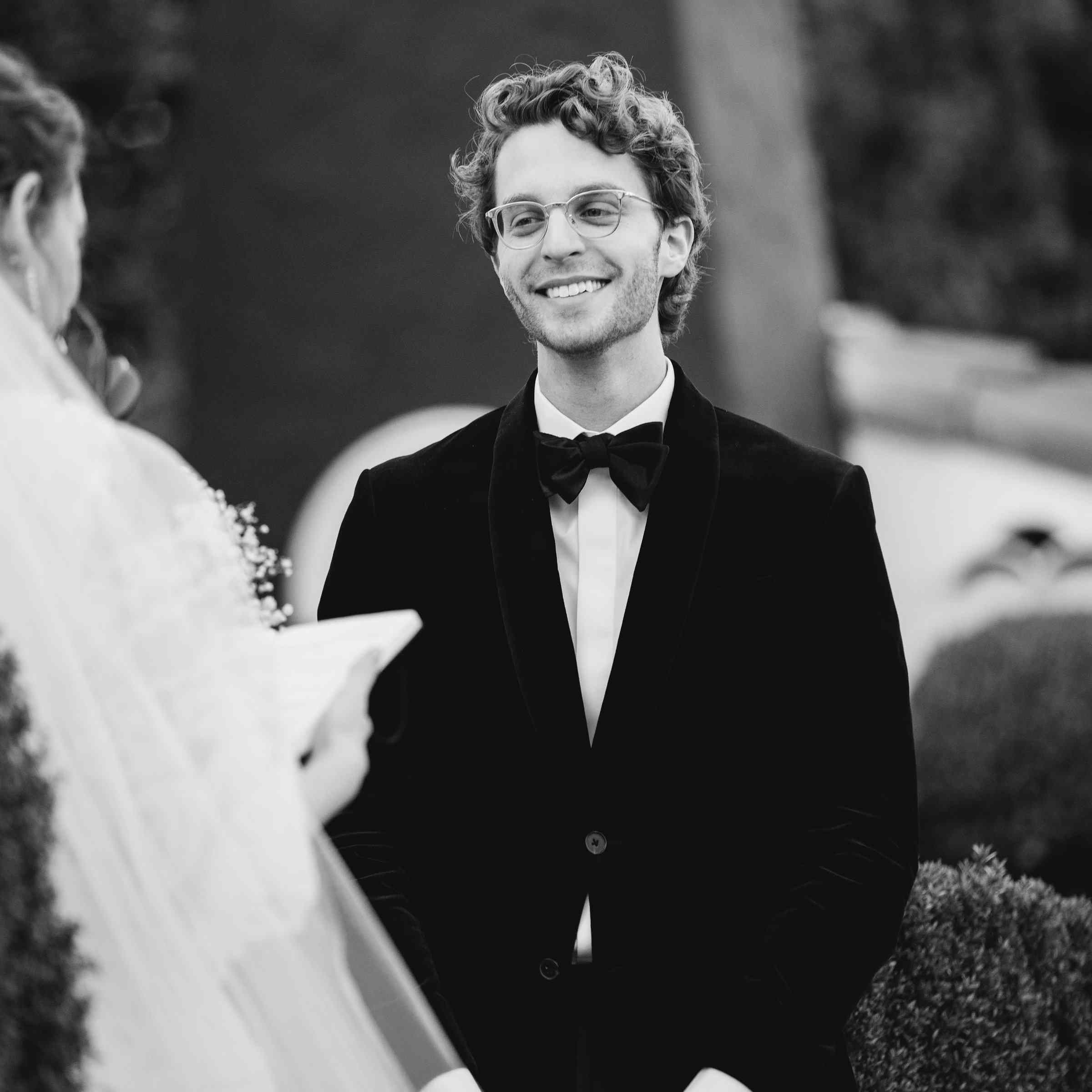 <p>smiling happy groom at altar</p><br><br>