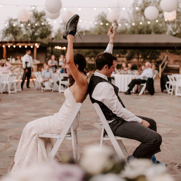 bride and groom playing wedding shoe game