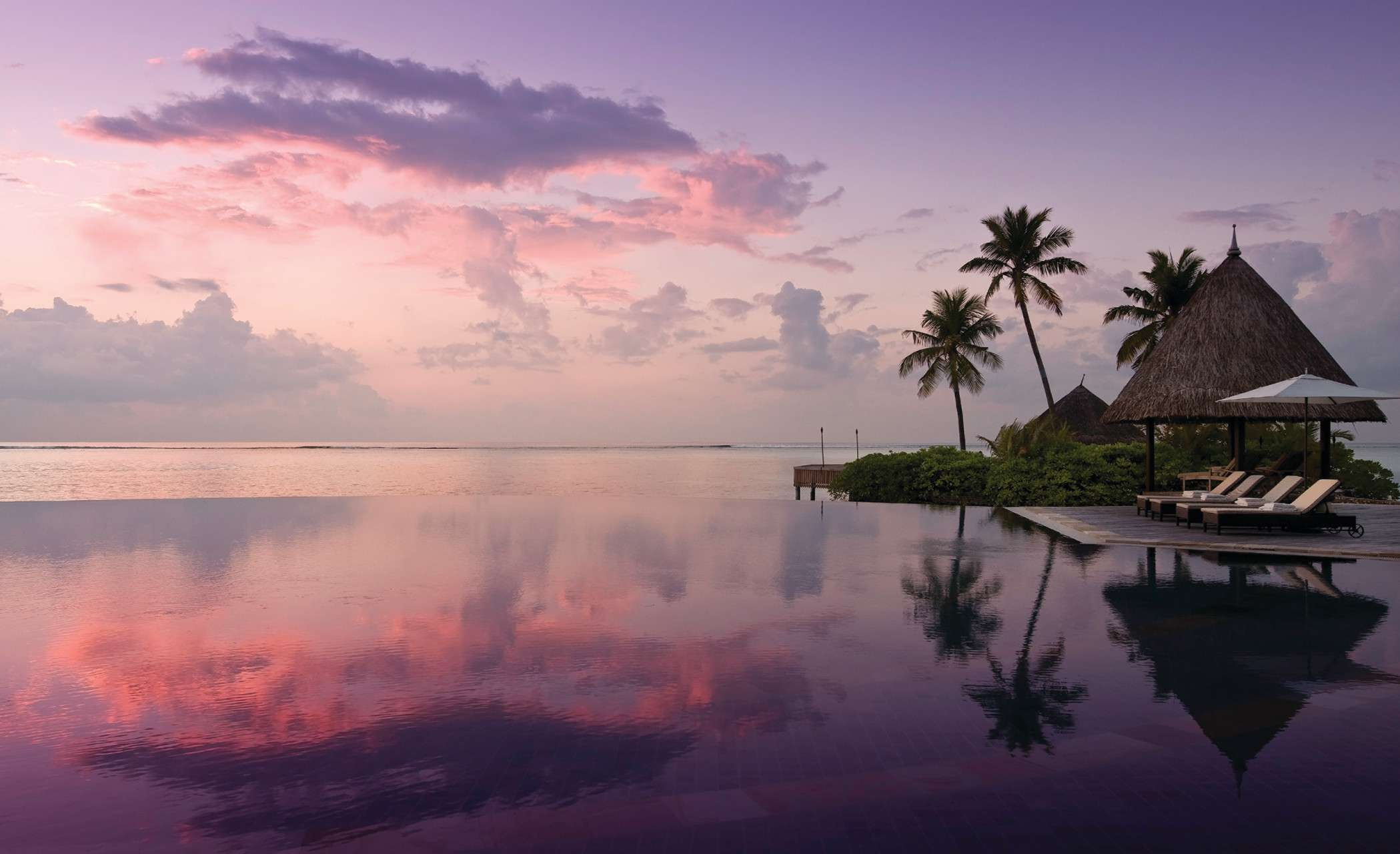 <p>A view of the pool at Four Seasons Resort Maldives at Kuda Huraa</p>