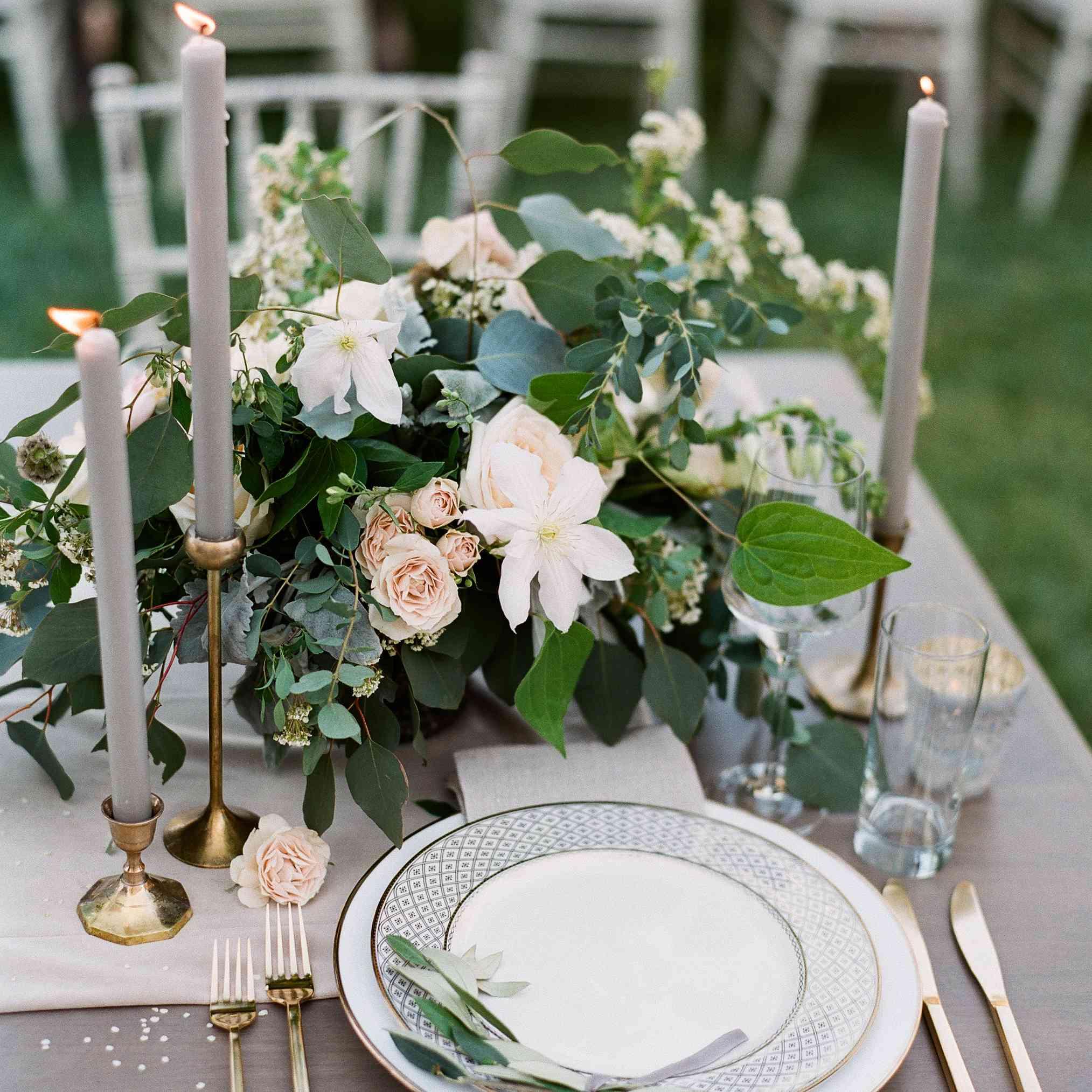<p>Gray farm table with floral arrangement.</p>