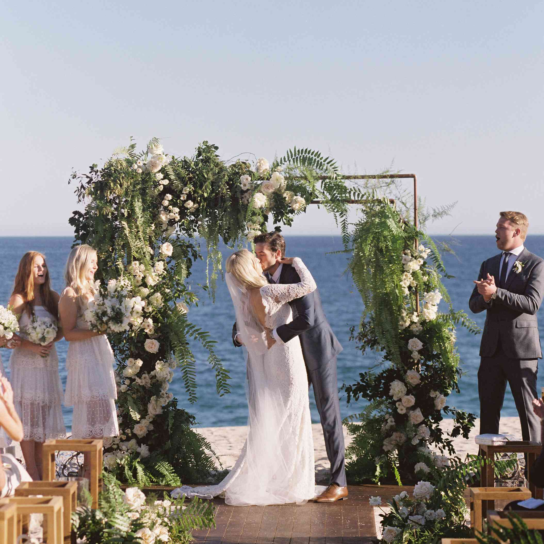 bride and groom kissing beach ceremony