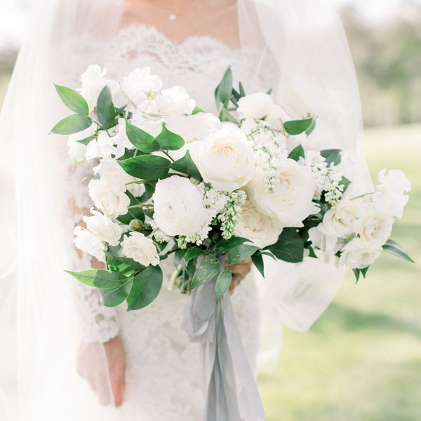 Bride holding all white wedding bouquet