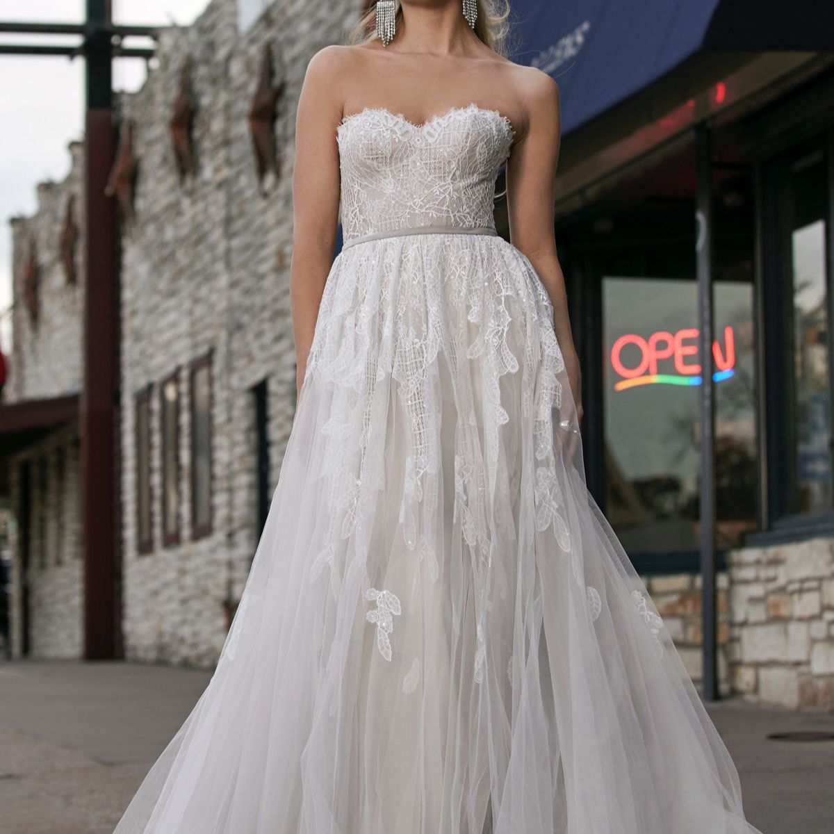 Model in strapless lacy sweetheart ballgown