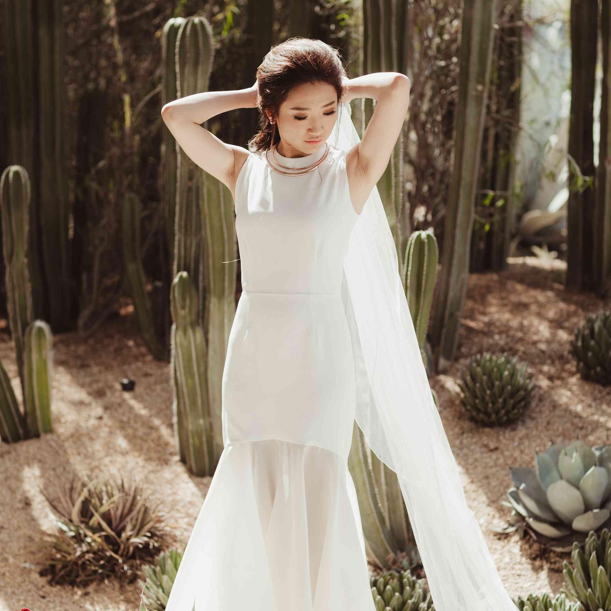 Bride standing in desert
