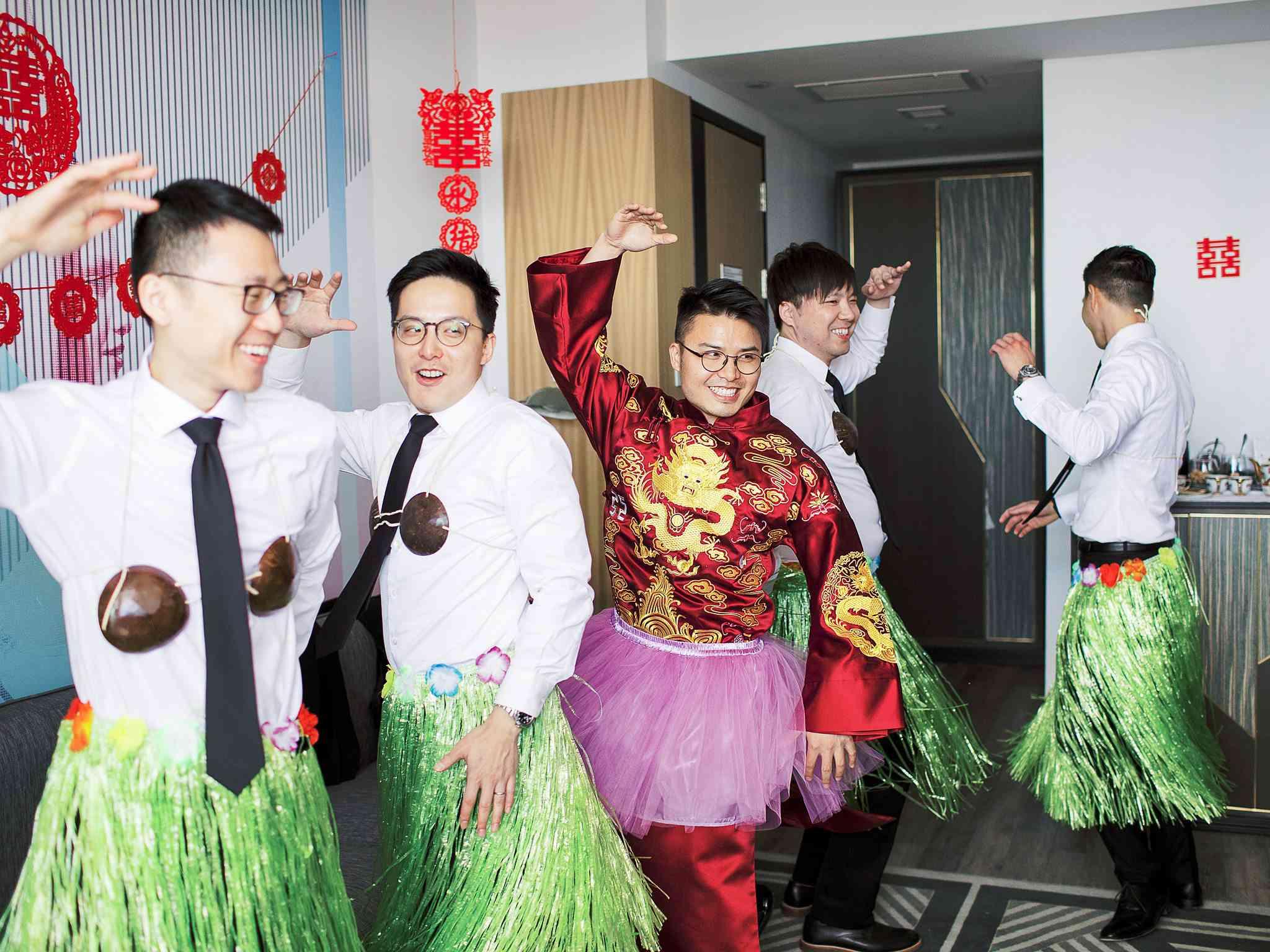 groomsmen hula dancing
