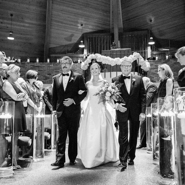 Father walking daughter down the aisle.