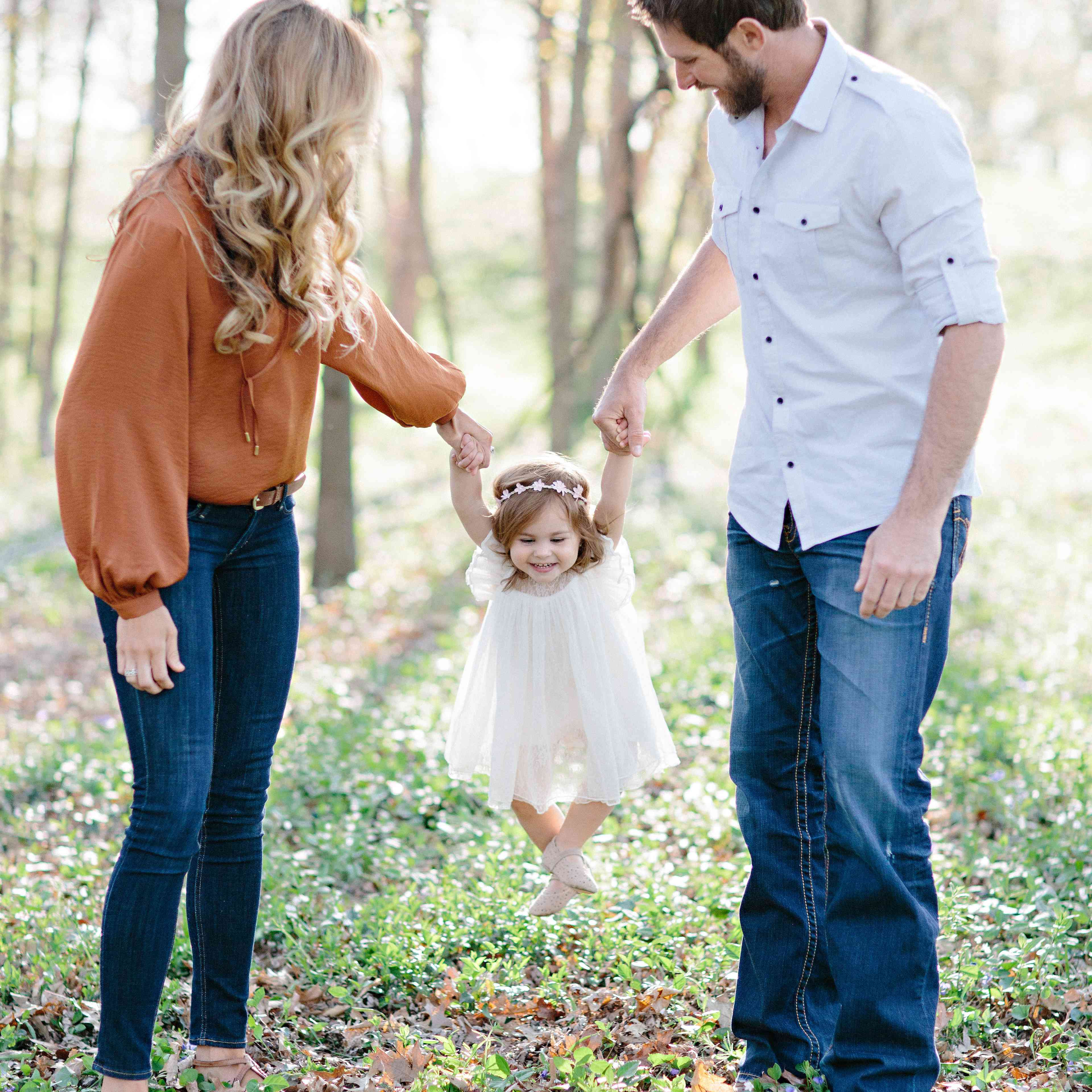 Couple carrying baby daughter