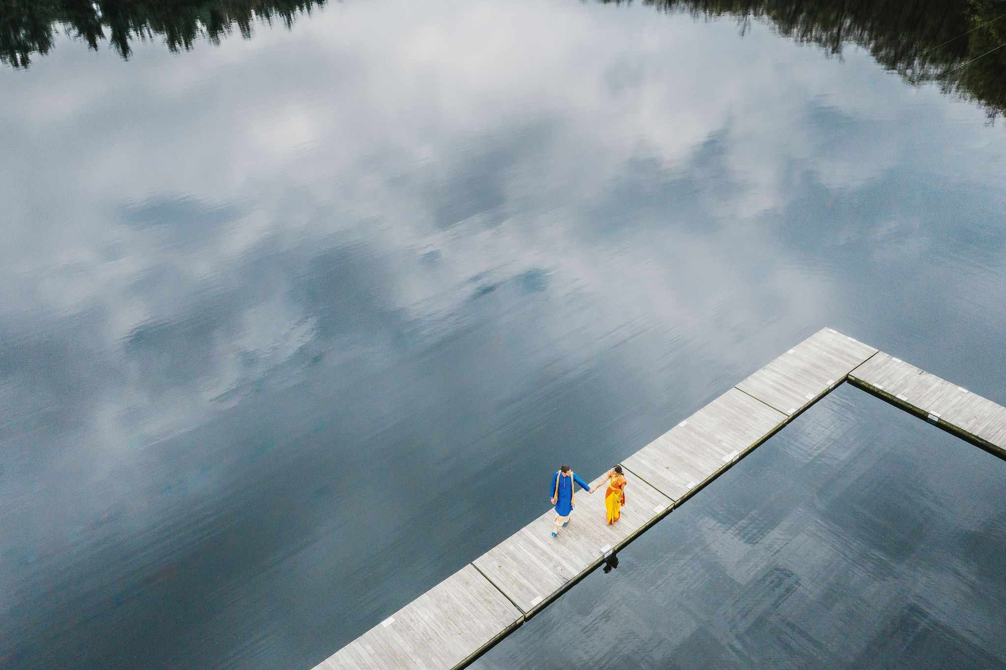 Aerial portrait of the couple by the lake