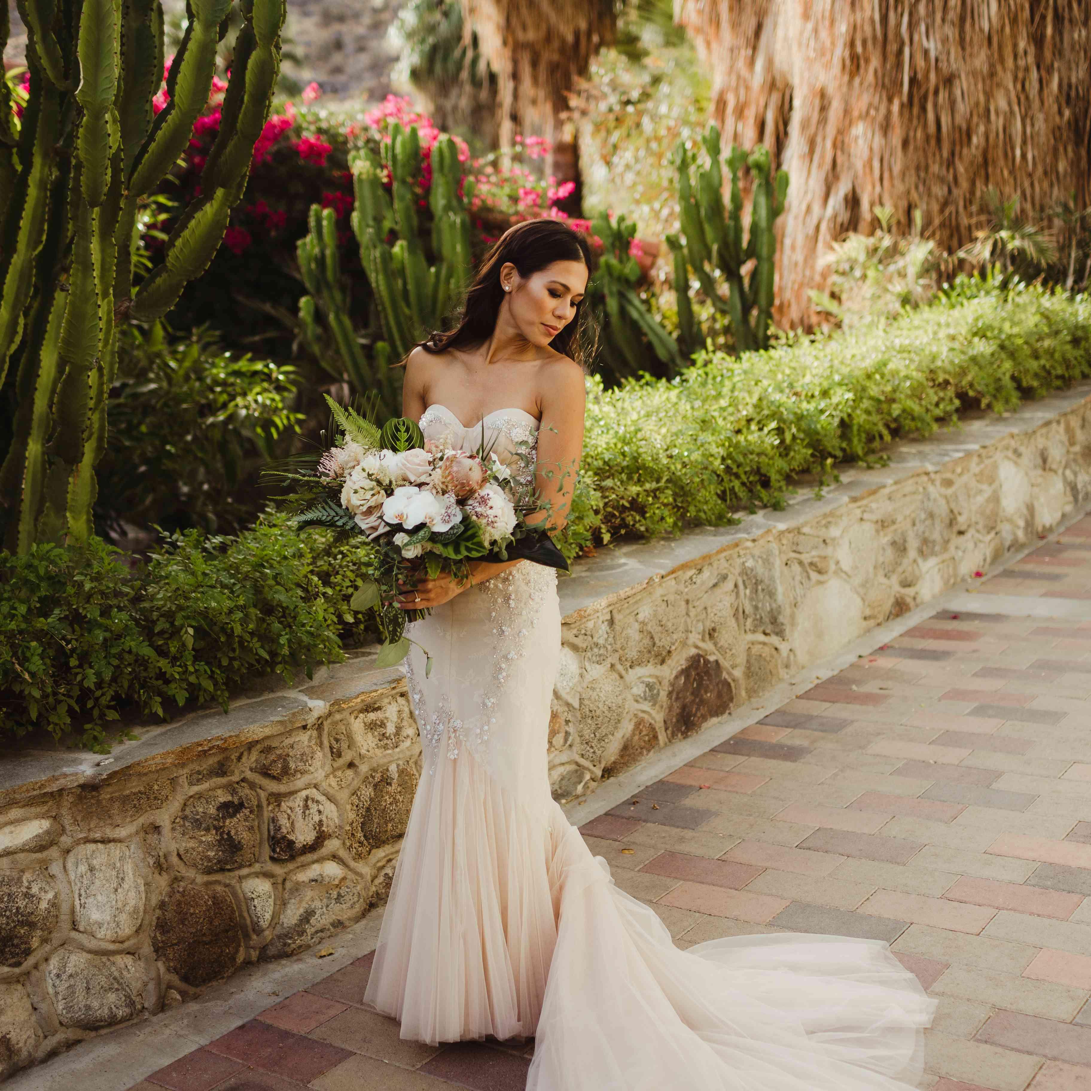 Bride solo shot holding bouquet