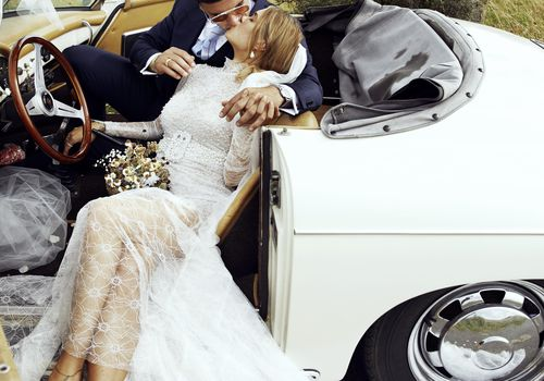 <p>Bride and Groom Kiss</p>