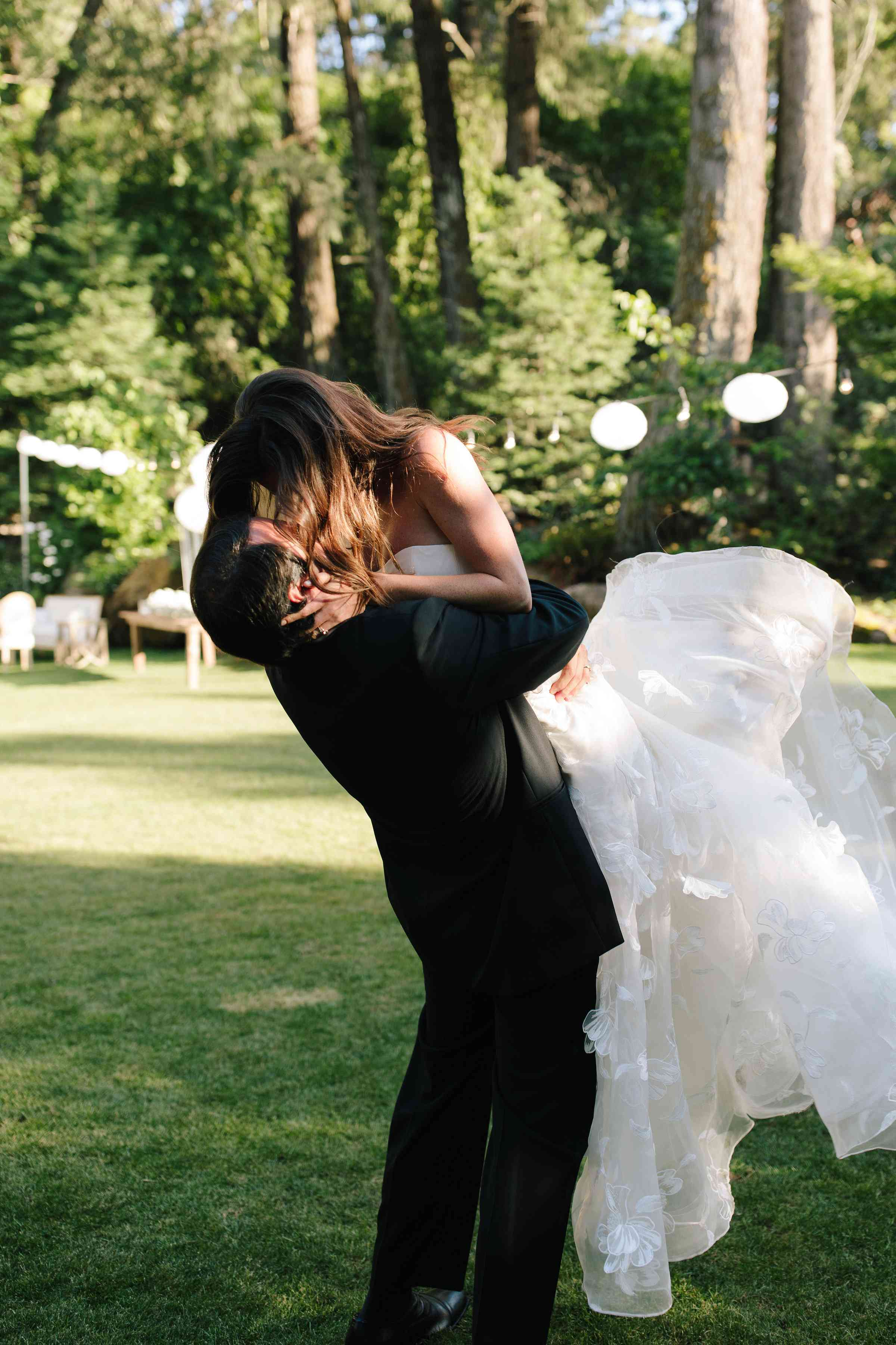 <p>groom picking up bride and kissing her</p><br><br>