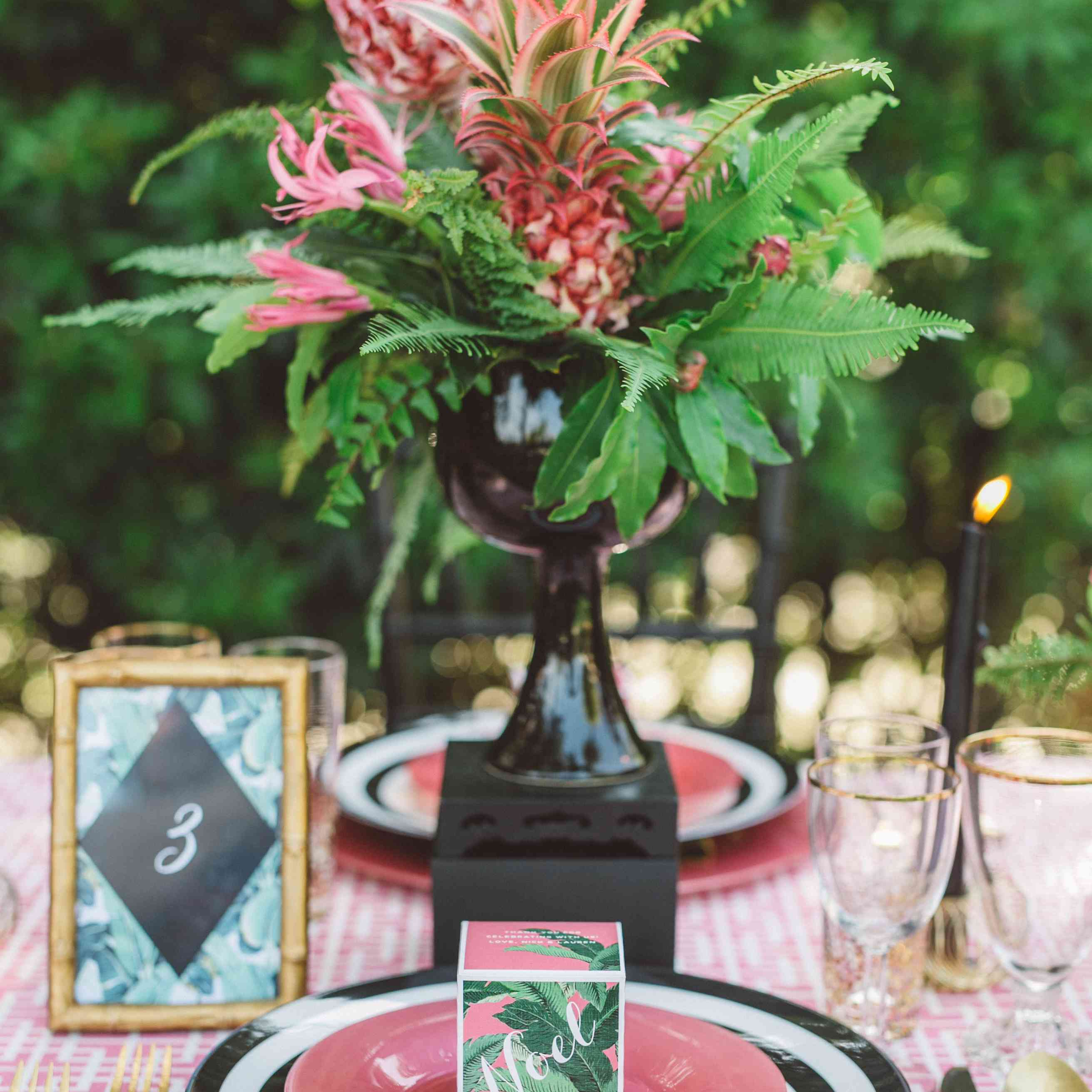 Pink pineapples and greenery as a centerpiece