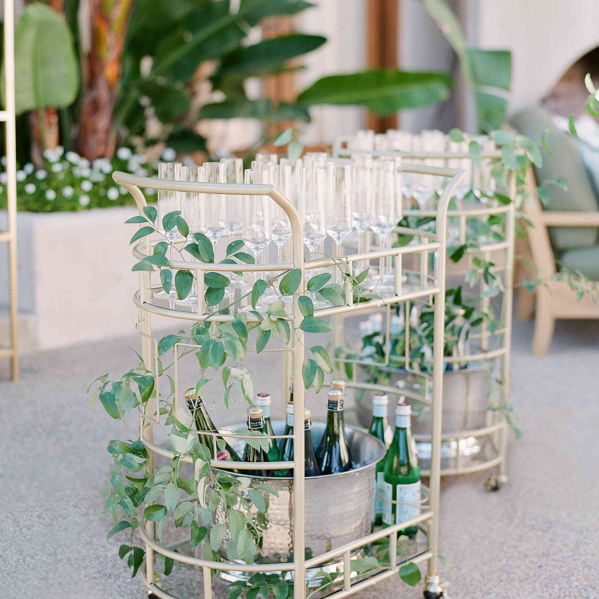 bar cart covered in decorative vines