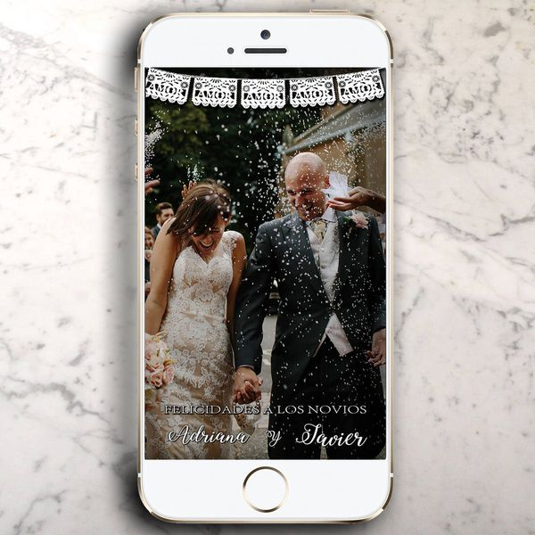 iPhone on a marble counter top with a wedding photo and geofilter in Snapchat
