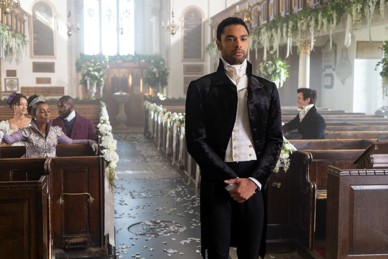 Simon awaits his bride in a decorated church.
